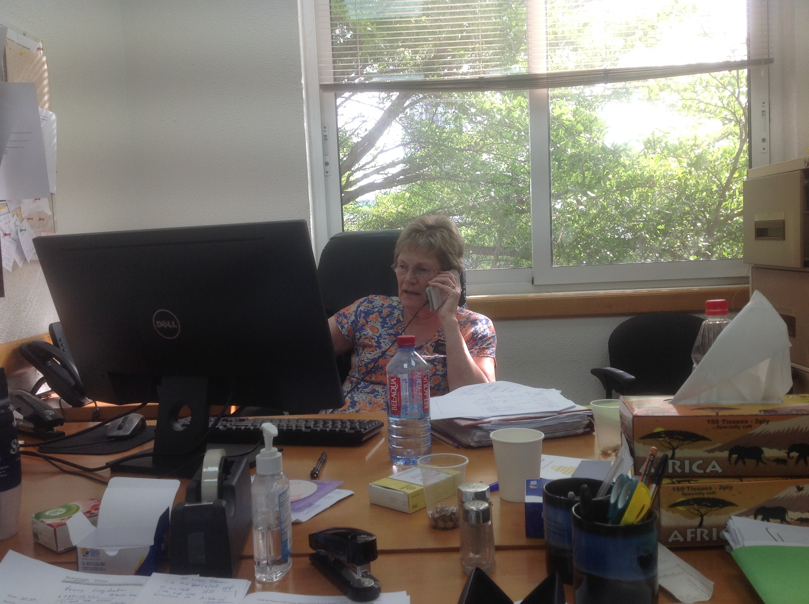 Sister Elizabeth Blackwell conducts phone consultations on her most recent mission in the Africa West Area.