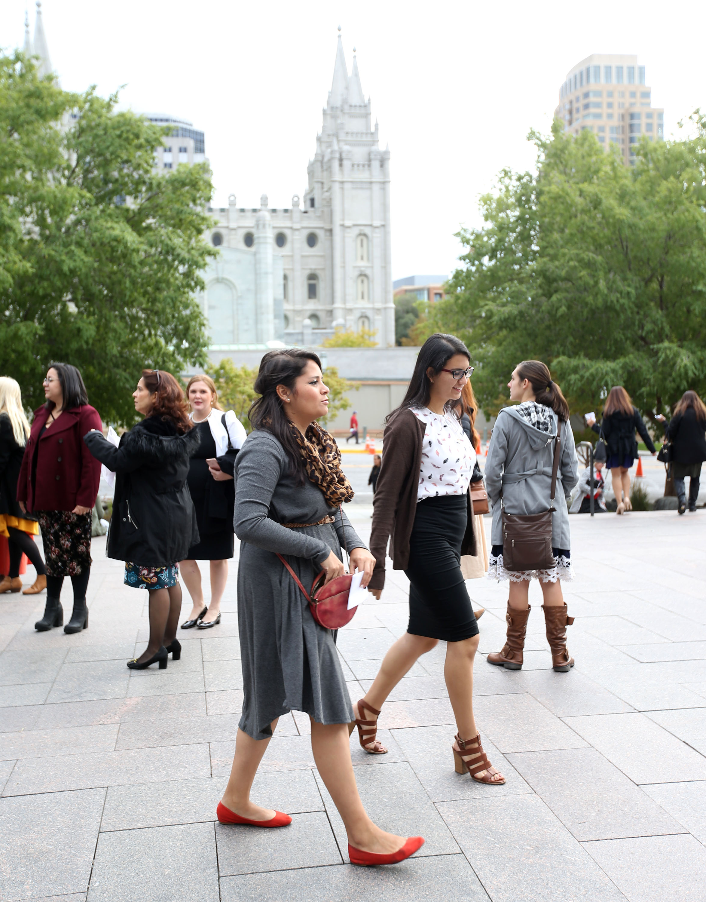 Women walk to the general women's session of the 188th Semiannual General Conference of The Church of Jesus Christ of Latter-day Saints held in the Conference Center in downtown Salt Lake City on Saturday, Oct. 6, 2018.