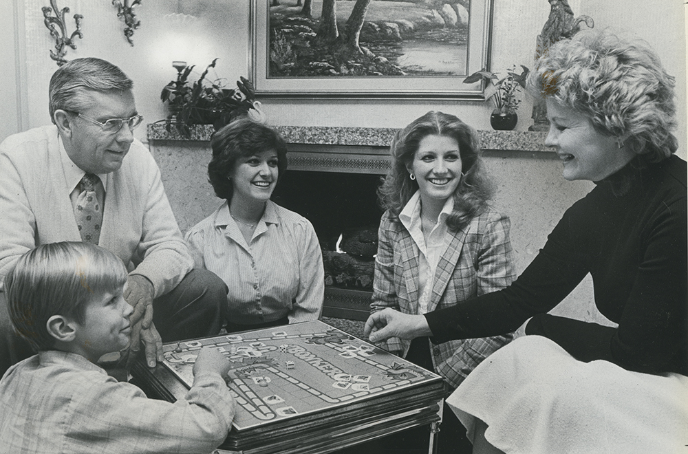 Then-Elder M. Russell Ballard, background left, and Sister Barbara B. Ballard, right, match wits and luck with family members in playing a game of Bonkers.