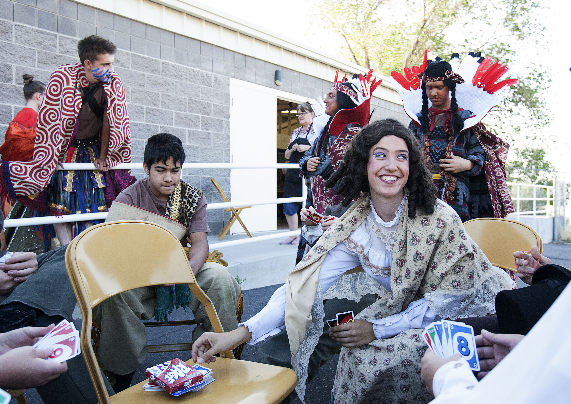 Samantha Olson, who portrays Mary Henshaw in the Mormon Miracle Pageant in Manti, smiles as she plays Uno with other actors before the show on Wednesday, June 15, 2016.