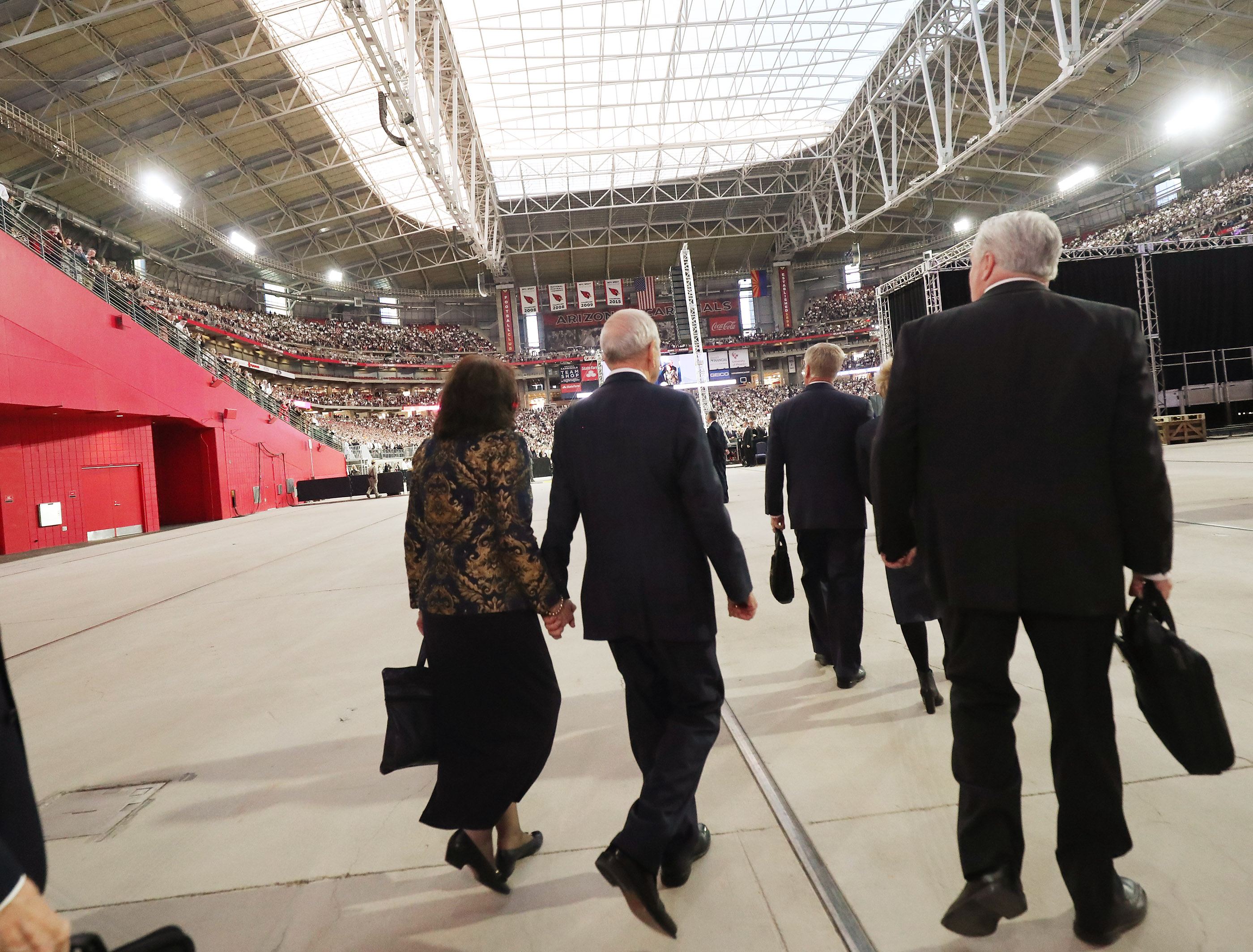 President Russell M. Nelson of The Church of Jesus Christ of Latter-day Saints walks into the State Farm Stadium with his wife, Sister Wendy Nelson, in Phoenix on Sunday, Feb. 10, 2019.