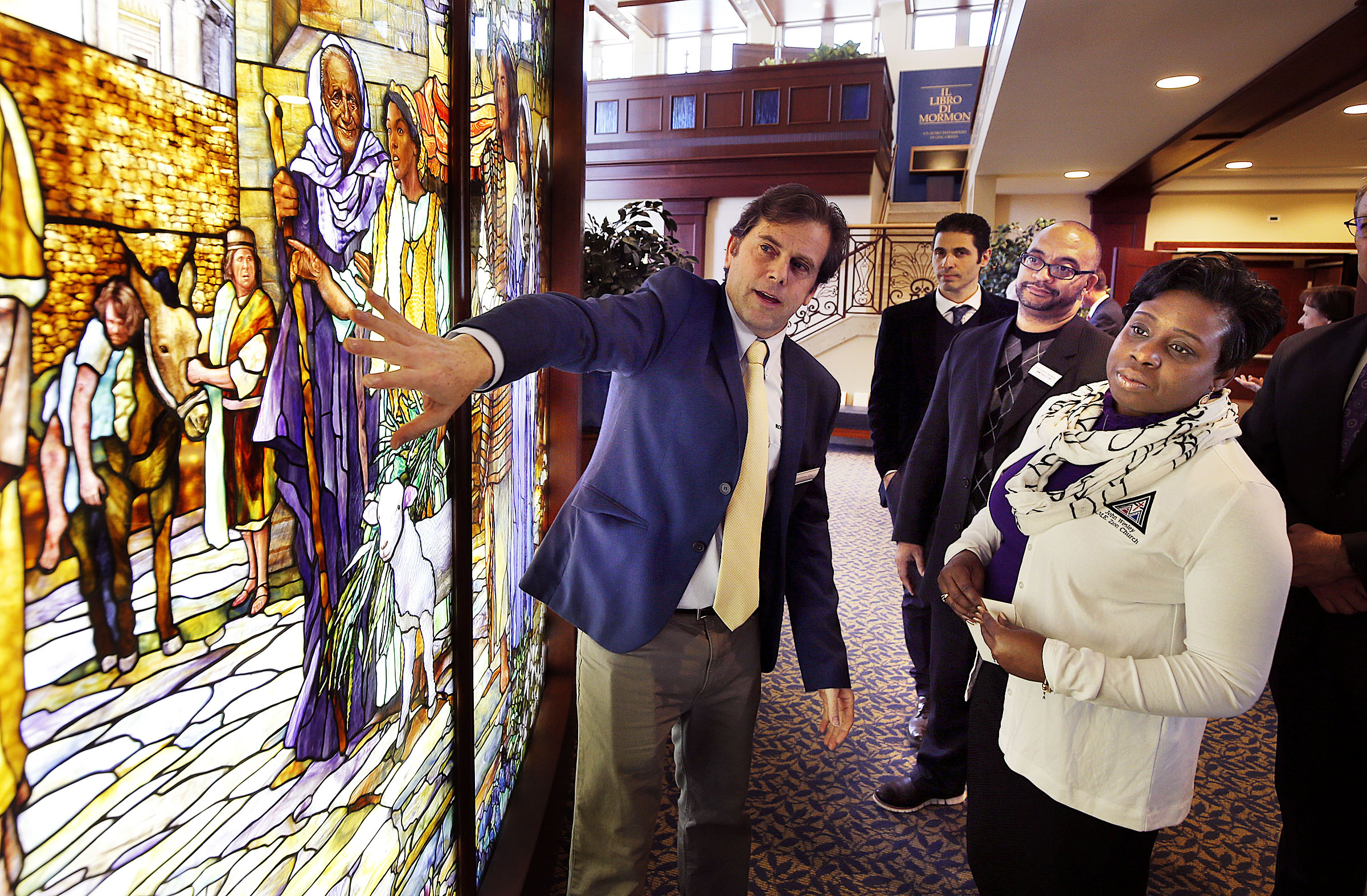 Tom Holdman, left, of Holdman Studios, discusses his company's stained glass work with Pastor Chris Zacharias and his wife, Kim, of the John Wesley A.M.E. Zion Church during a tour of the Rome Italy Temple and the Rome Italy Temple Visitors' Center on Tuesday, Jan. 15, 2019.
