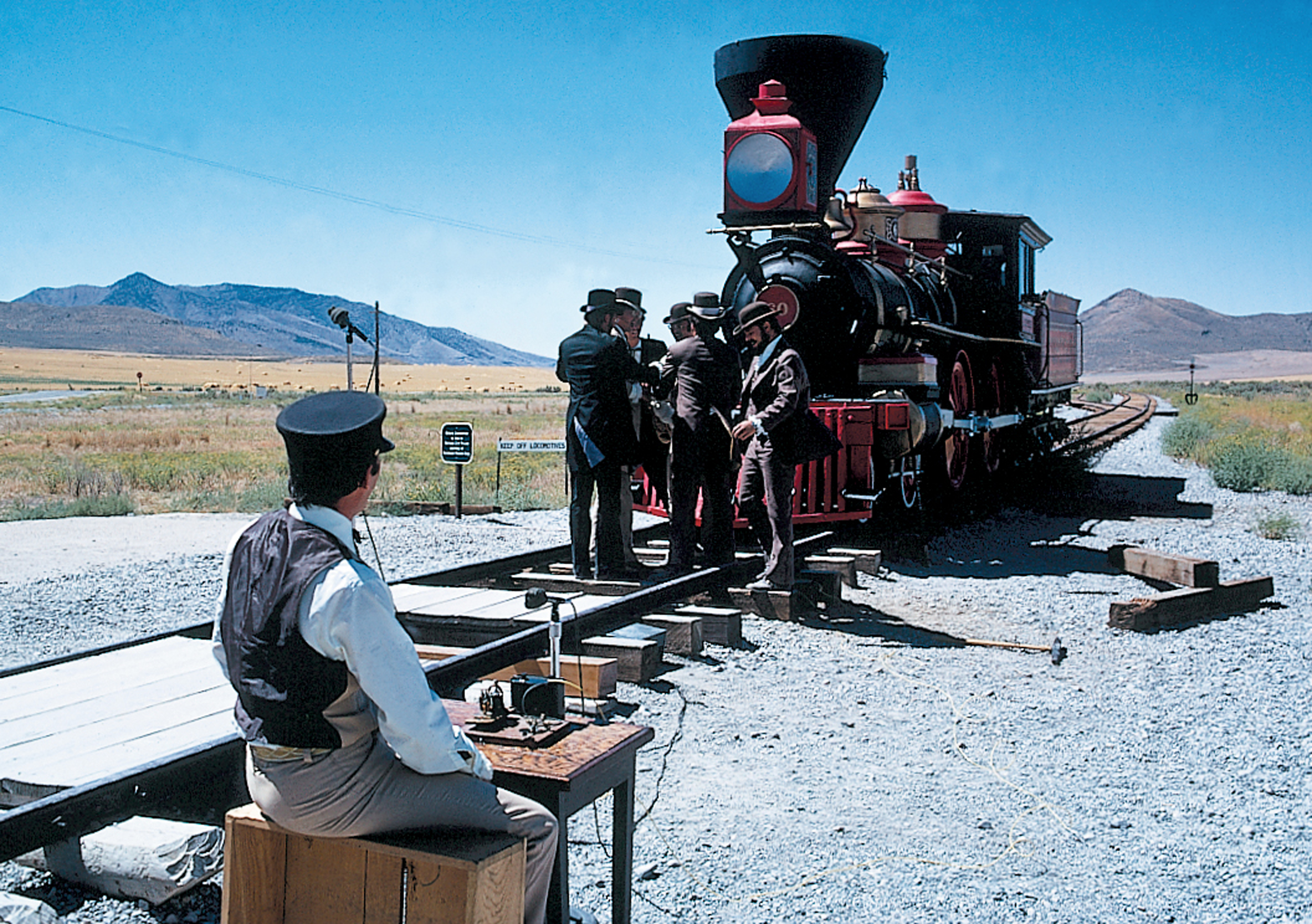 Workers prepare for the reenactment of the driving of the golden spike at Promontory Summit, Utah.