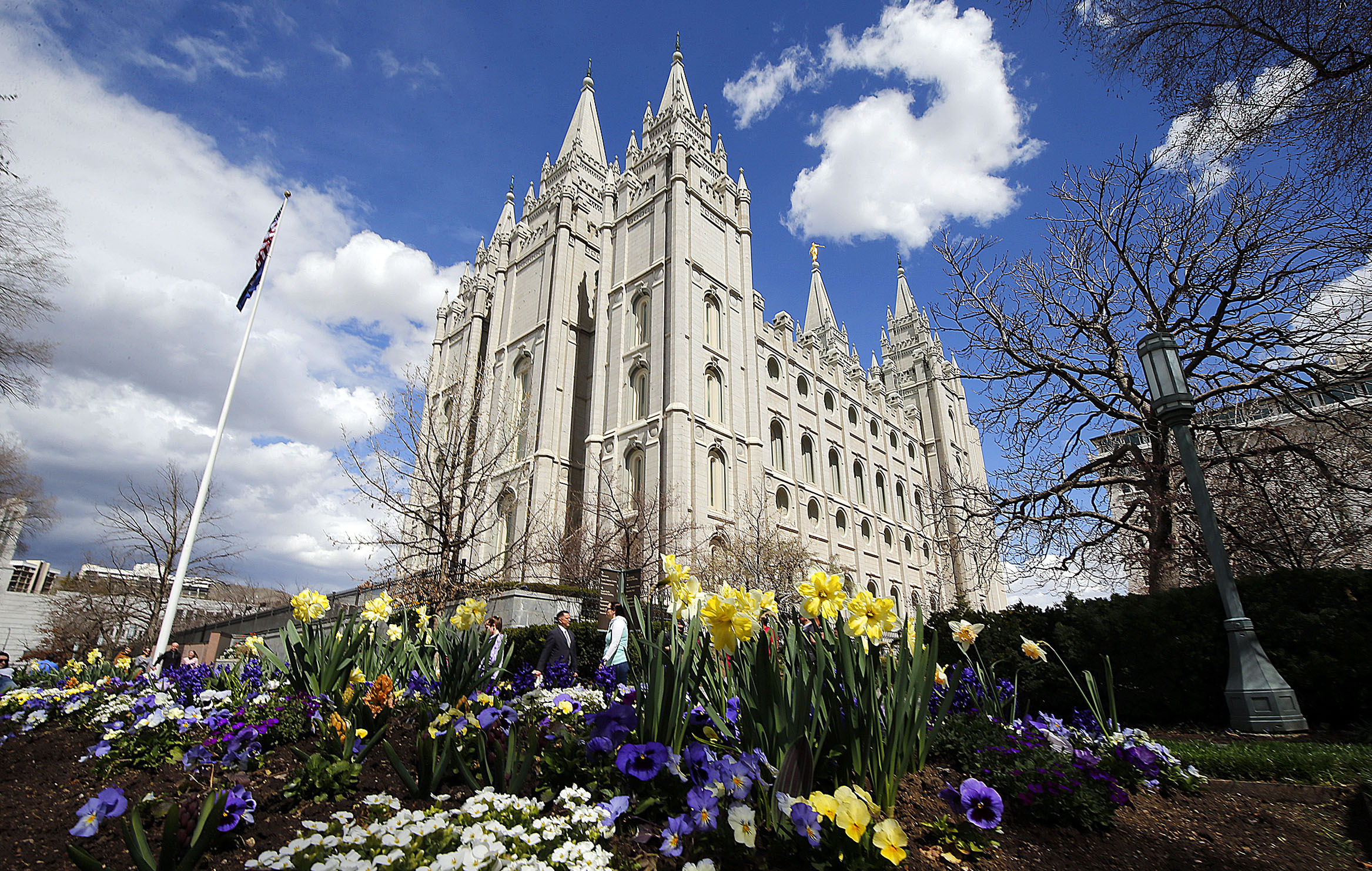 Flowers bloom near the Salt Lake Temple of The Church of Jesus Christ of Latter-day Saints in Salt Lake City on Friday, April 5, 2019. Leaders of The Church of Jesus Christ of Latter-day Saints discontinued a policy Monday morning, May 6, requiring couples who marry civilly to wait one year before being sealed in the temple.