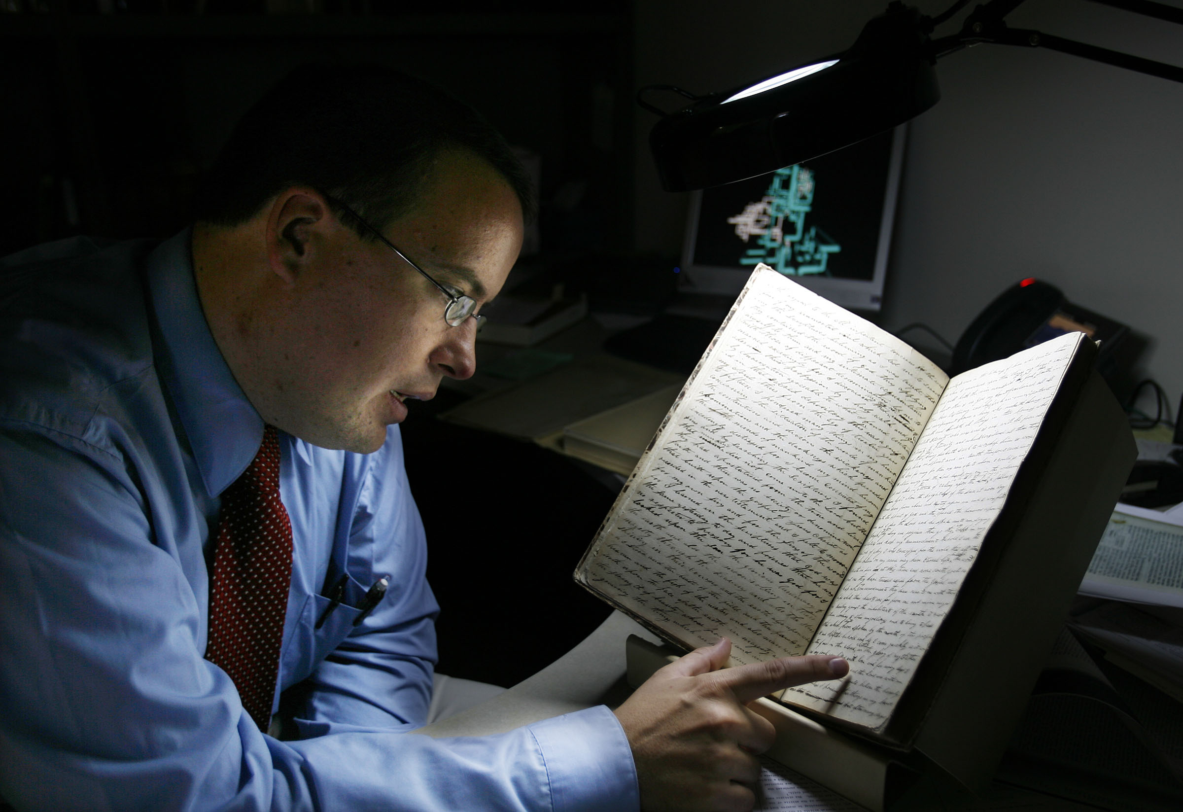 Robin Jensen looks over the Letterbook #1, which was written or dictated by Joseph Smith, at the Church History Library in Salt Lake City, Utah, Friday, Sept. 11, 2009. Jensen is working on the Joseph Smith Papers project