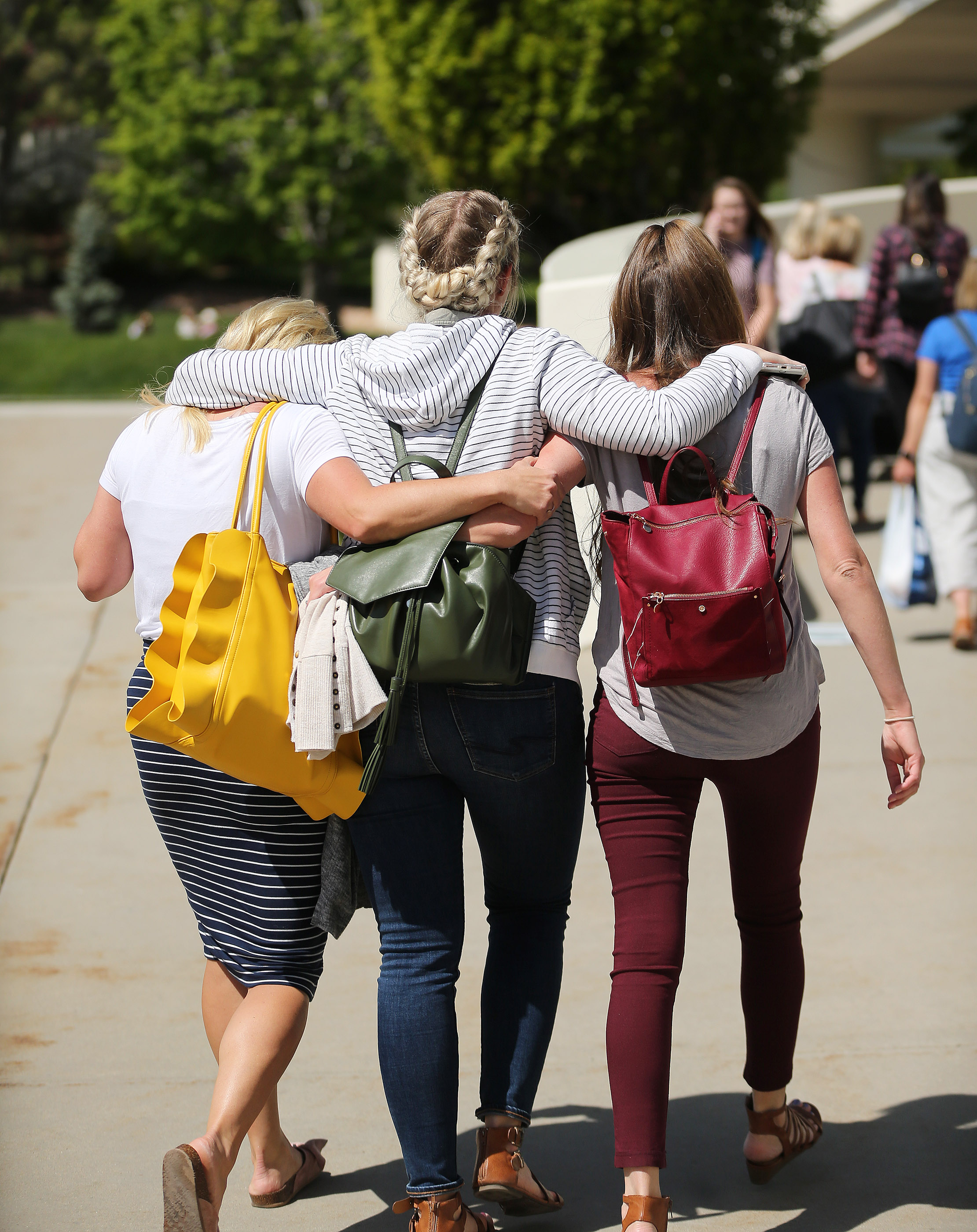 Women walk arm in arm during BYU Women's Conference in Provo on Friday, May 3, 2019.