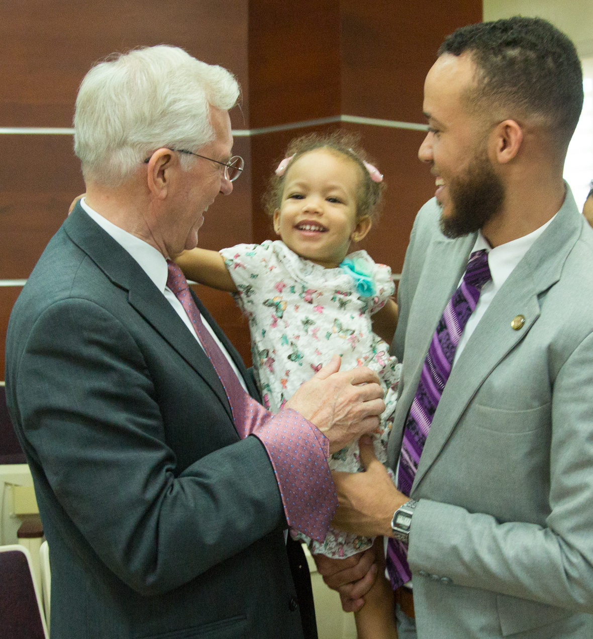 Elder D. Todd Christofferson makes a new friend at a conference of the Santo Domingo Dominican Republic Geronimo Stake on Nov. 11, 2018.
