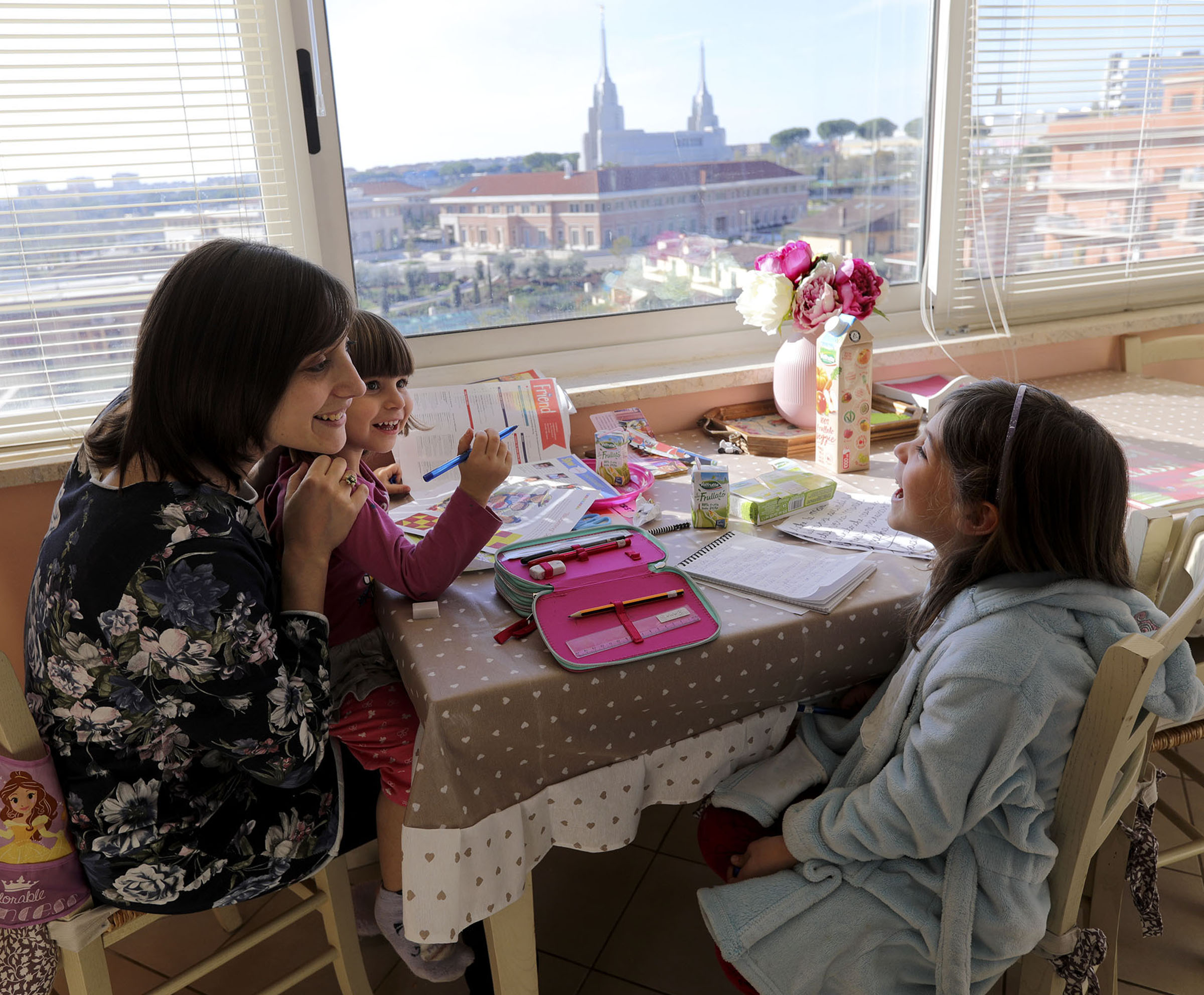 Norma Salerno chats with her daughters, Alice and Emma, at the kitchen table, overlooking the Rome Temple, at home in Rome, Italy, on Sunday morning, Nov. 18, 2018.