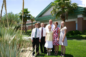 The Painter family -- from left, Zaquary, Matthew, Jamie, father Phil, mother Jill and Joni -- stand in front of one of the many modern meetinghouses in Las Vegas. Their family brought additional strength to the Church in the area.