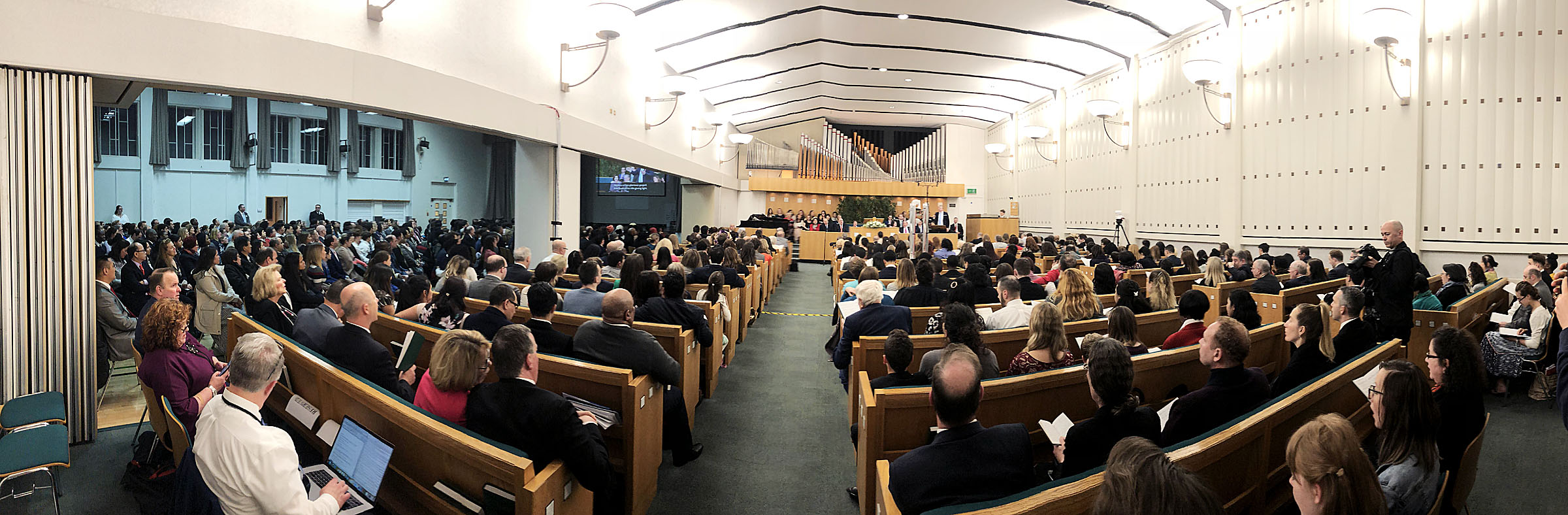 Members of the congregation sing at the end of a meeting with President Russell M. Nelson at the Hyde Park Chapel in London on Thursday, April 12, 2018.