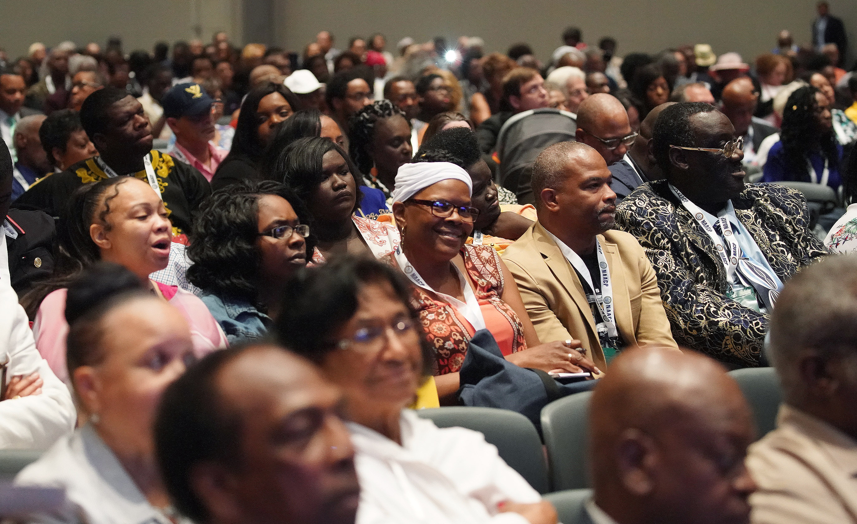 Attendees listen to speakers at the 110th annual national convention for the National Association for the Advancement of Colored People in Detroit on Sunday, July 21, 2019.
