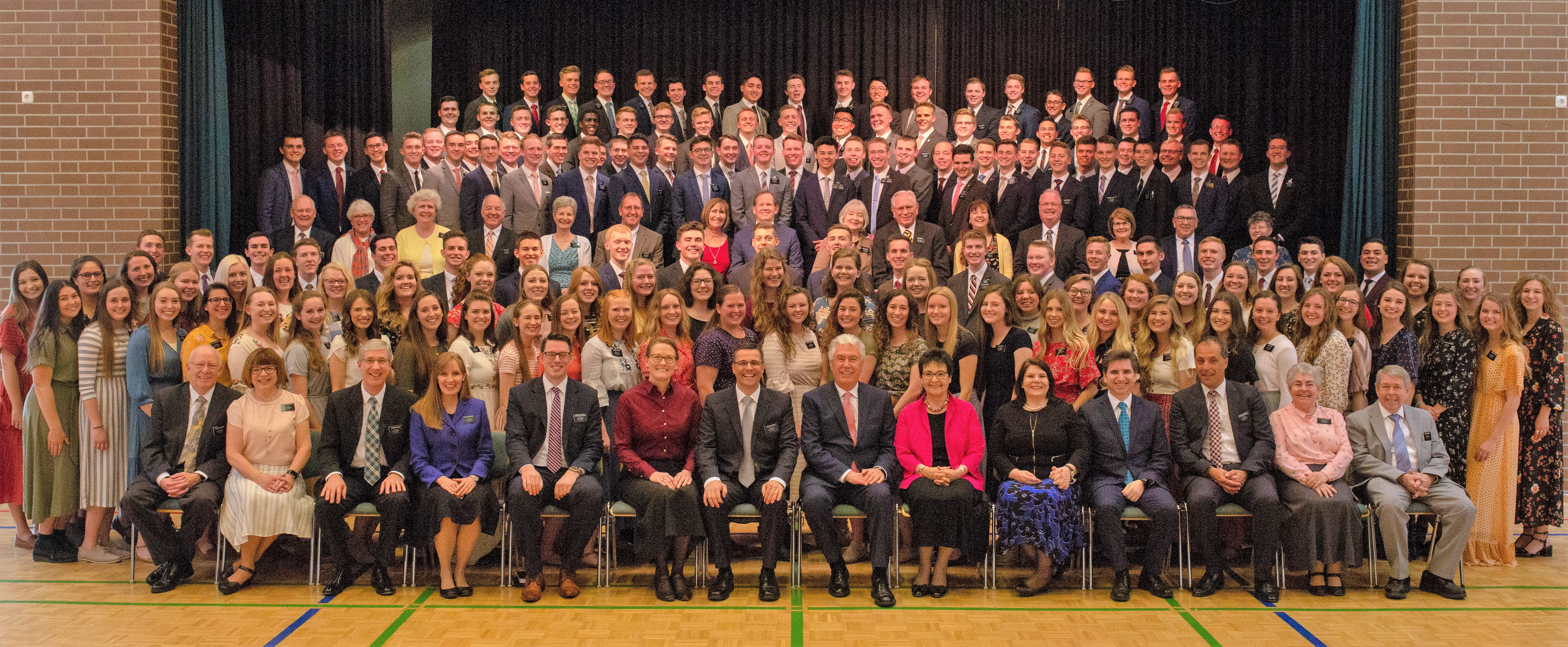 Elder Dieter F. Uchtdorf and his wife, Sister Harriet Uchtdorf, are front and center in a mission photo with the leaders and missionaries of the Germany Berlin Mission on April 26, 2019.