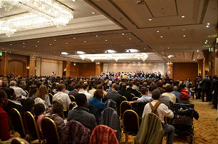 Church members in France gather to hear Elder Neil L. Andersen of the Quorum of the Twelve and his wife, Sister Kathy Andersen, at a devotional in Paris. This year marks 20 years since the Church's sixth stake in France — the Bordeaux France Stake — was created. Elder Andersen was presiding over the France Bordeaux Mission when President Boyd K. Packer created the stake in 1992.