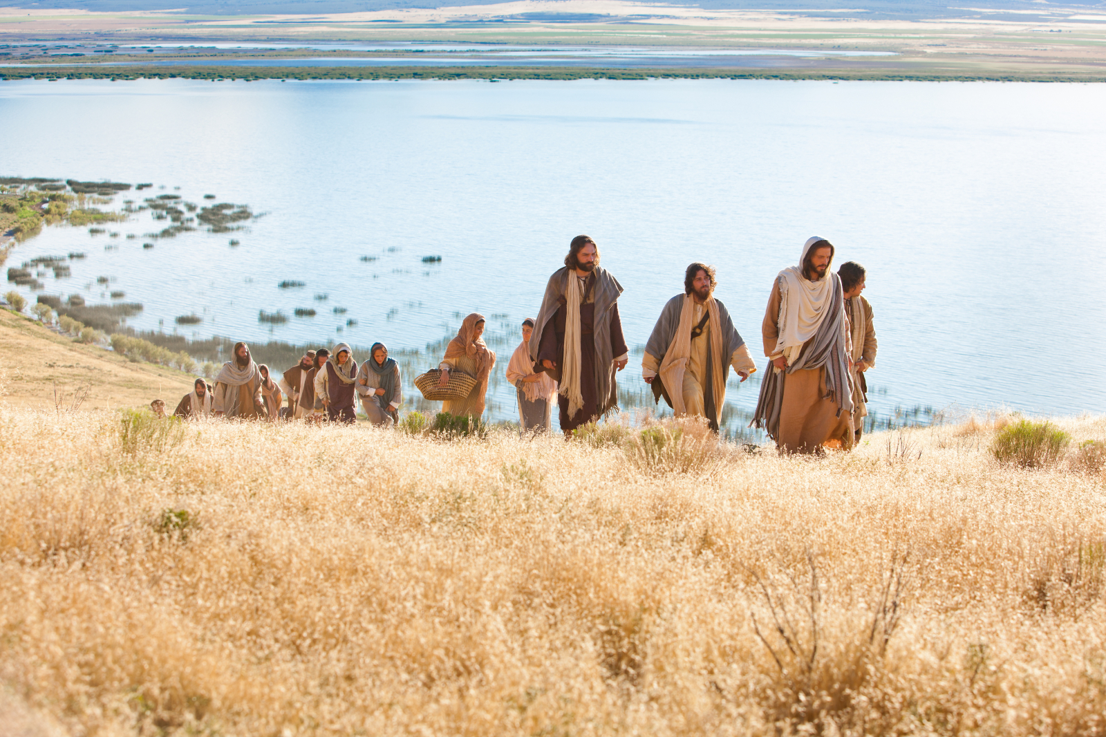 A scene from the Church's Bible videos depicts the Savior walking with men and women before He gave His Sermon on the Mount.