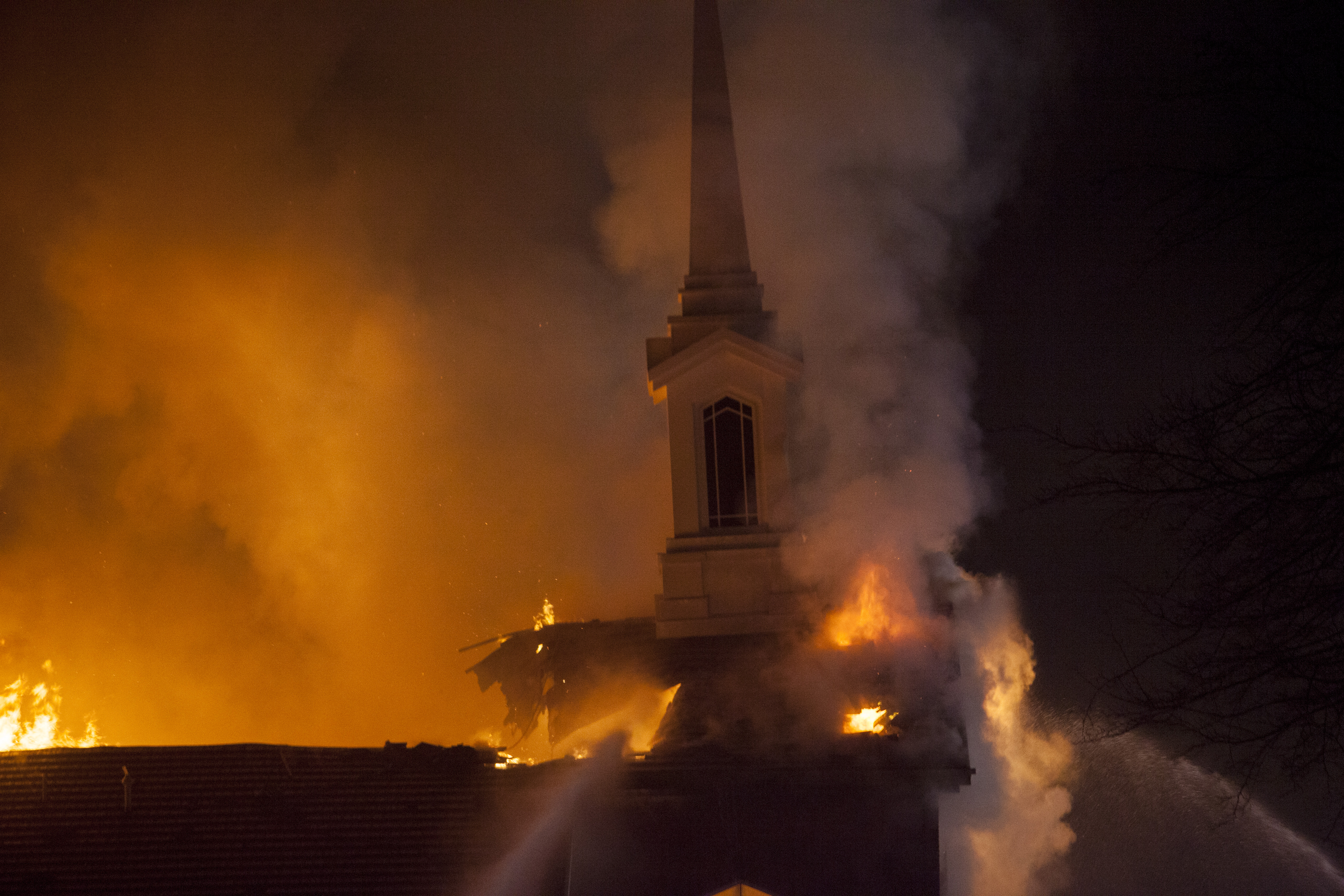 Fire departments from St. George, Utah, and around Washington County work to control a fire at the under-construction St. George East Stake meetinghouse Saturday, Jan. 26, 2019.