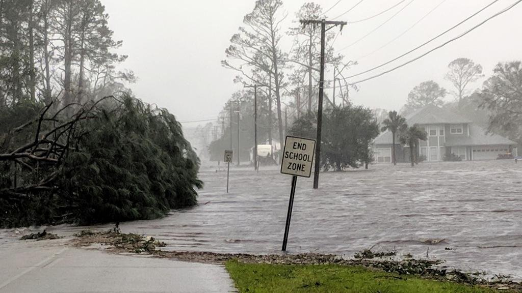 Hurricane Michael formed off the coast of Cuba carrying major Category 4 landfall in the Florida Panhandle. Surge in the Big Bend area, along with catastrophic winds at 155mph. Storm surge floods 20th St in Port St. Joe, Fla., Wednesday, Oct. 10, 2018, after Hurricane Michael makes landfall in the Florida Panhandle. (Douglas R. Clifford/The Tampa Bay Times via AP)
