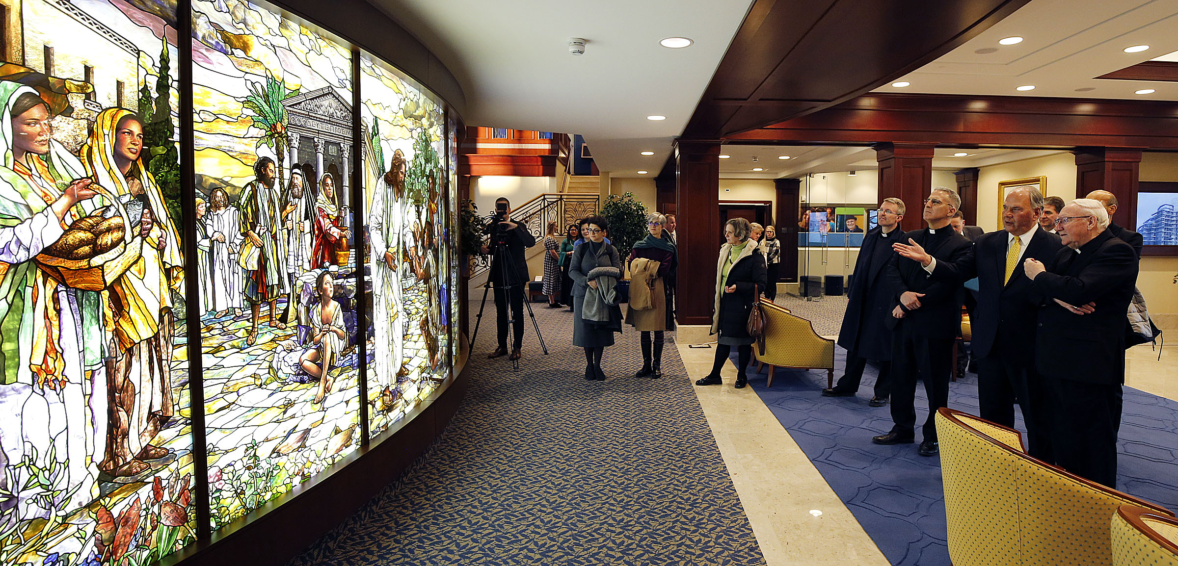 Elder Ronald A. Rasband, second from right, of The Quorum of the Twelve Apostles, talks with Brian Farrell, right, Secretary of the Pontifical Council for Promoting Christian Unity, as they view stained glass in the Rome Italy Temple Visitors' Center on Tuesday, Jan. 15, 2019.