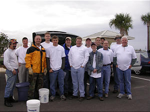 A team of men from the Oviedo area of Seminole County, Florida, gather to offer aid after tornadoes left a 70-mile path of destruction through their state. An estimated 15 member homes were damaged or destroyed.