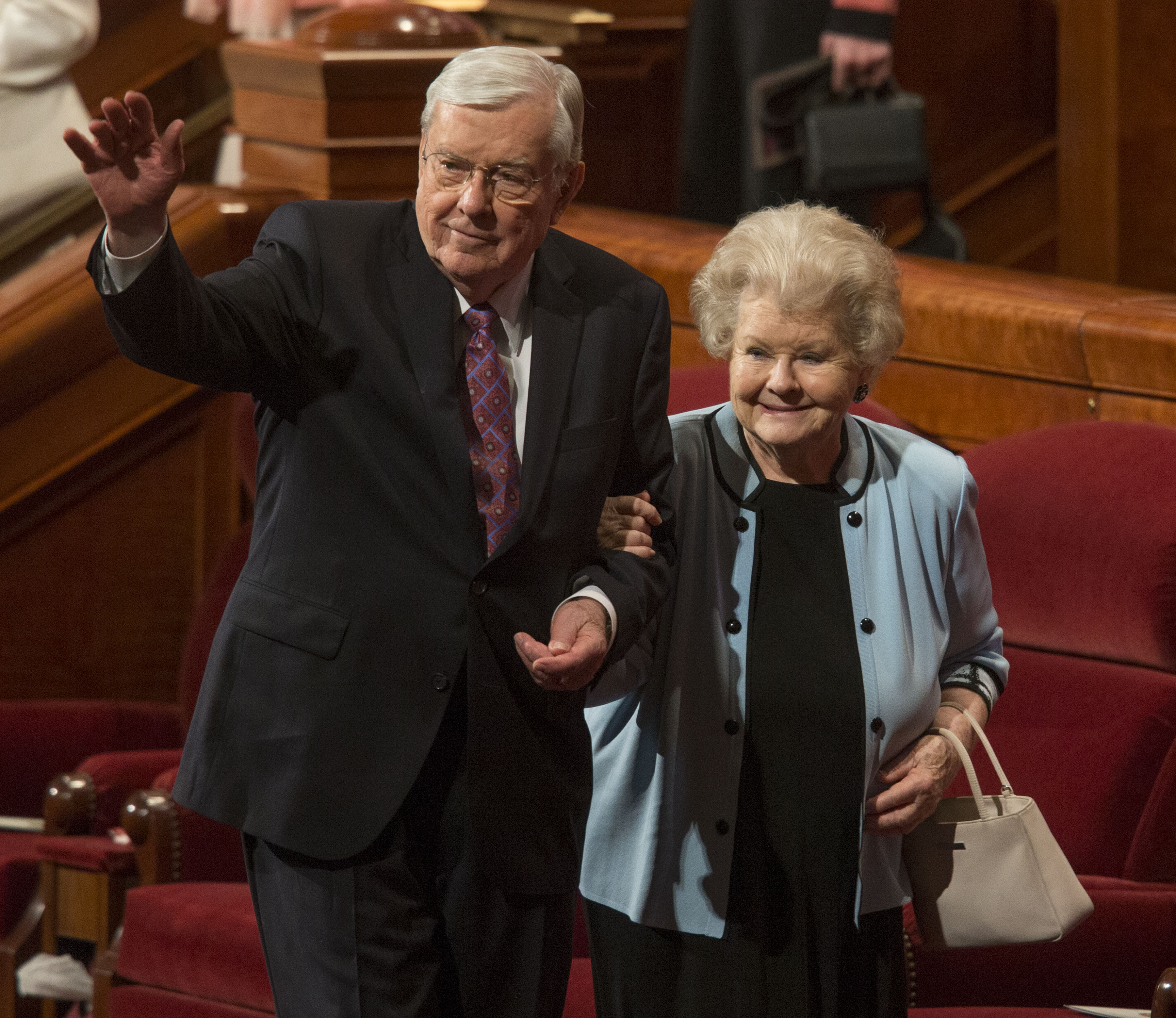 Elder M. Russell Ballard of the Quorum of the Twelve Apostles and his wife, Sister Barbara B. Ballard, exit the stand following the Sunday morning session of the 184th Annual General Conference Sunday, April 6, 2014, at the Conference Center in Salt Lake City.