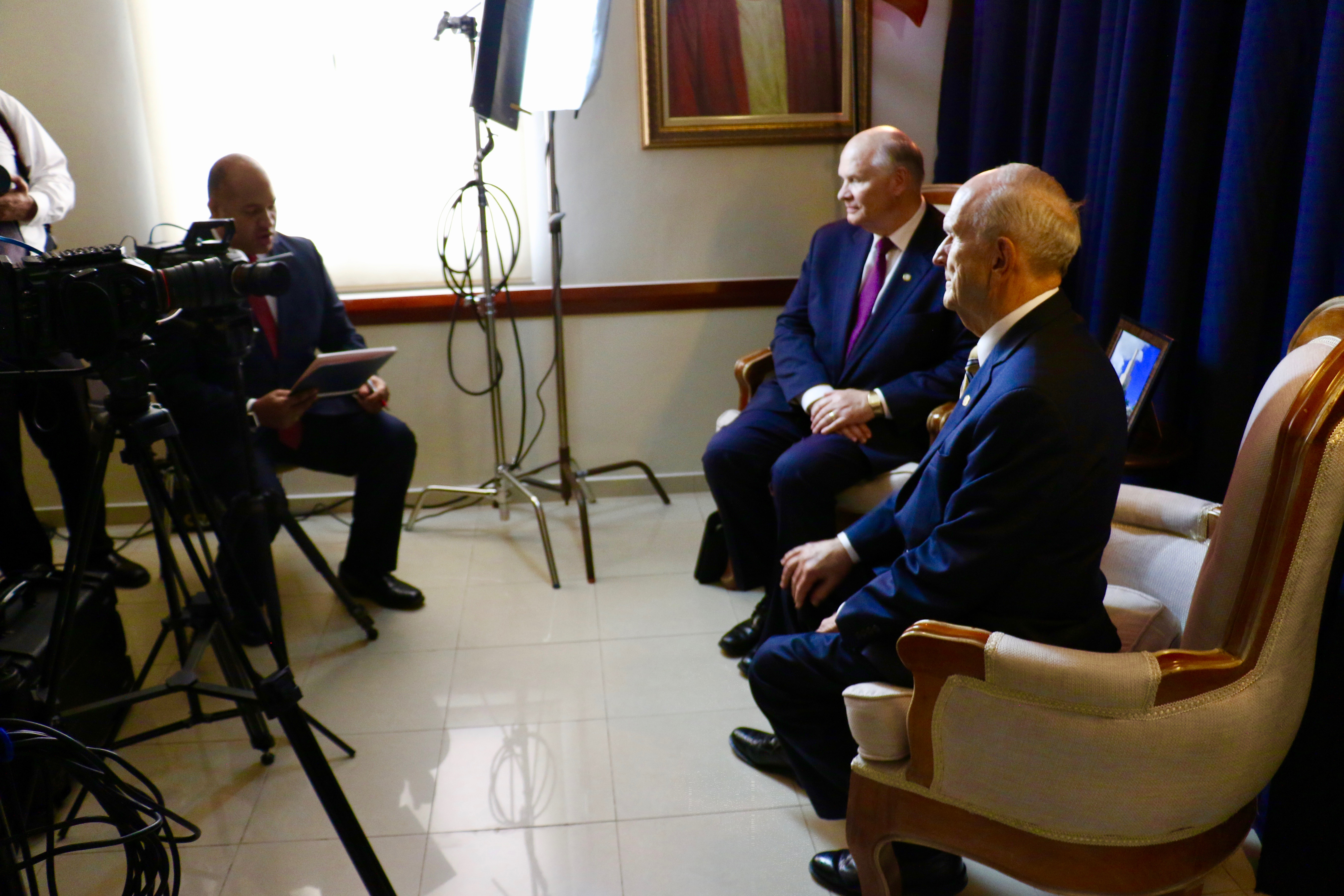 President Russell M. Nelson, right, and Elder Dale G. Renlund are interviewed by local media following a Sept. 1, 2018, member devotional in Santo Domingo, Dominican Republic.