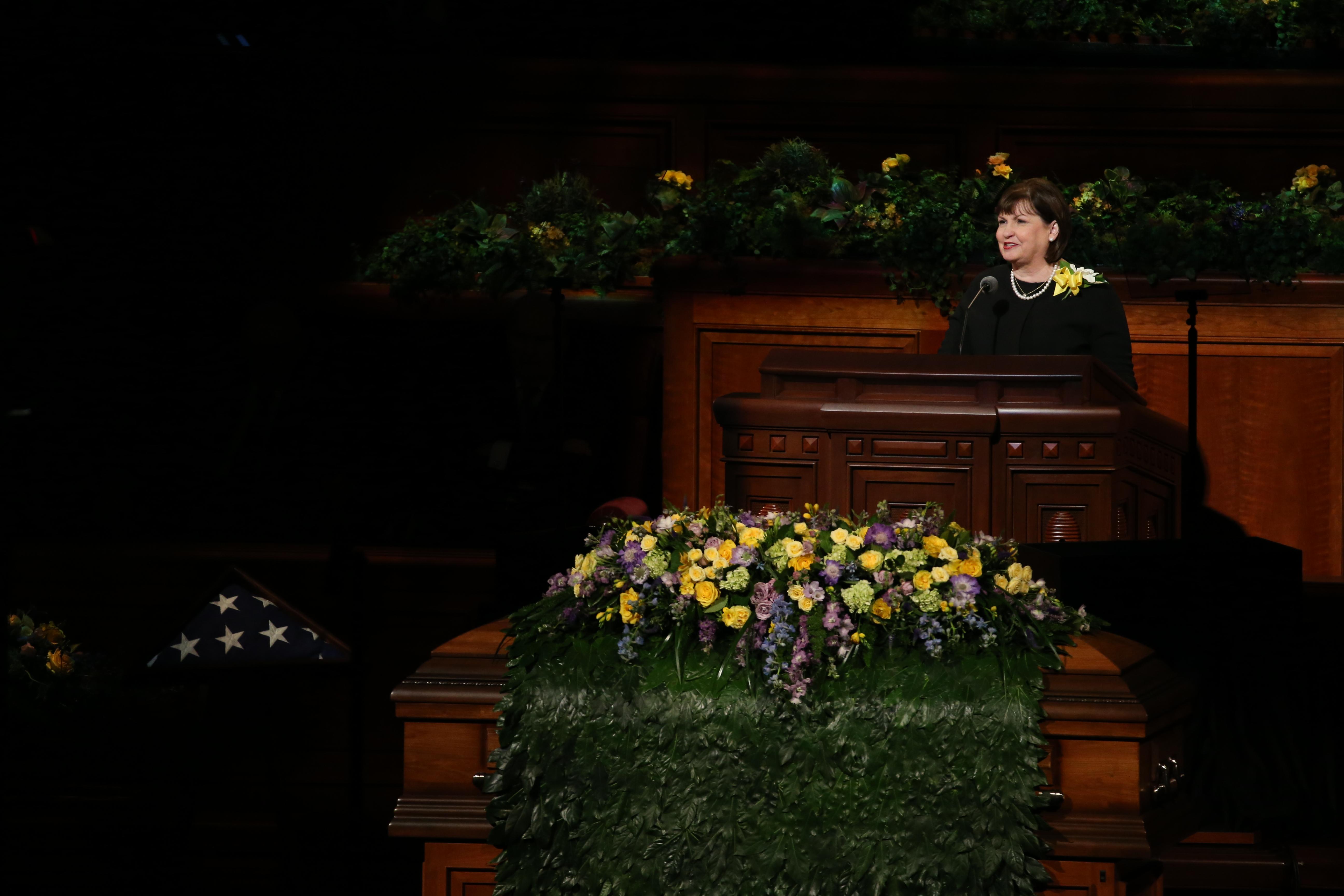 Sister Ann M. Dibb, daughter of President Thomas S. Monson, speaks his funeral at the Conference Center in Salt Lake City on Friday, Jan. 12, 2018.
