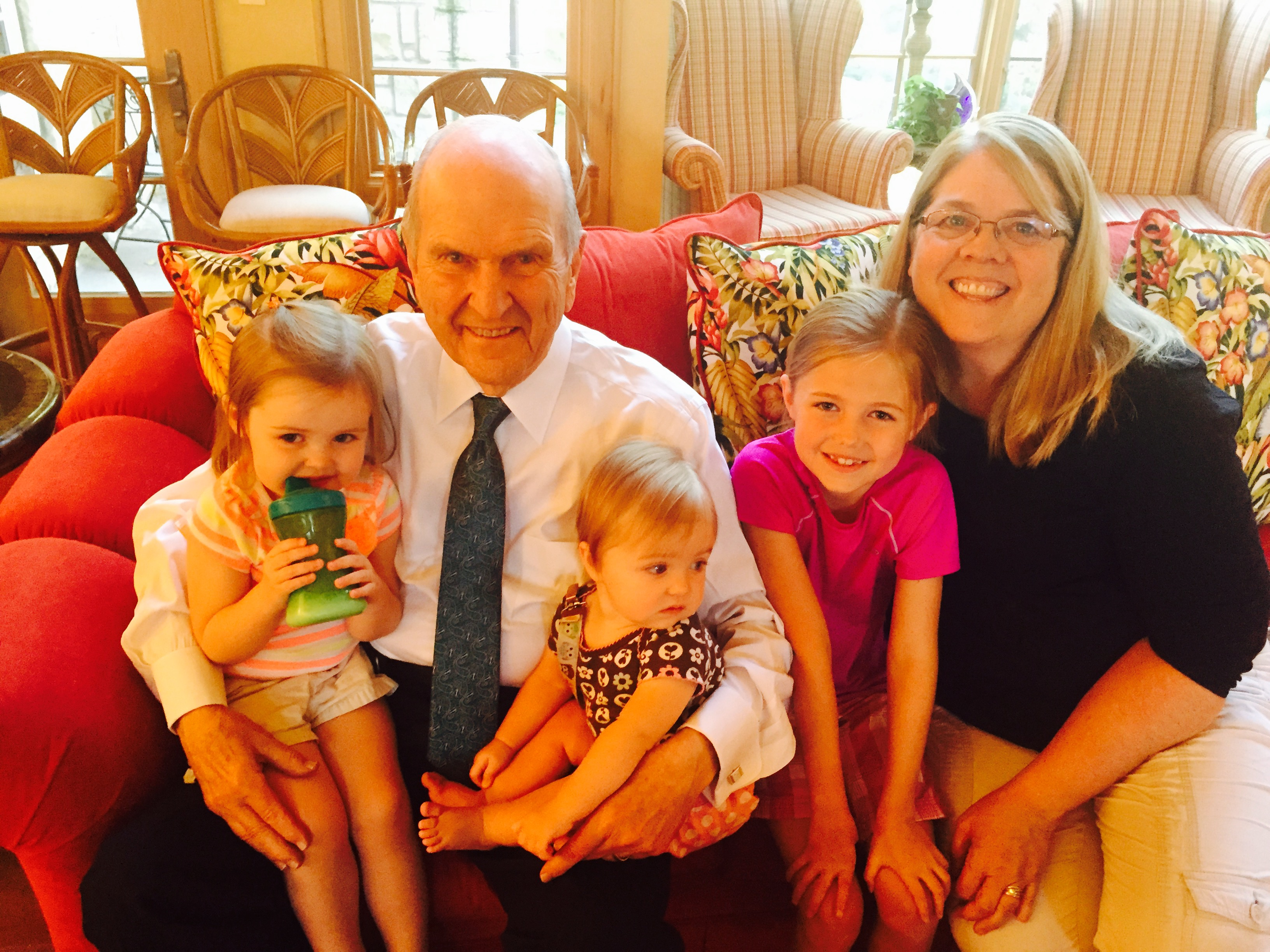 President Russell M. Nelson with daughter Sylvia and great grandchildren.
