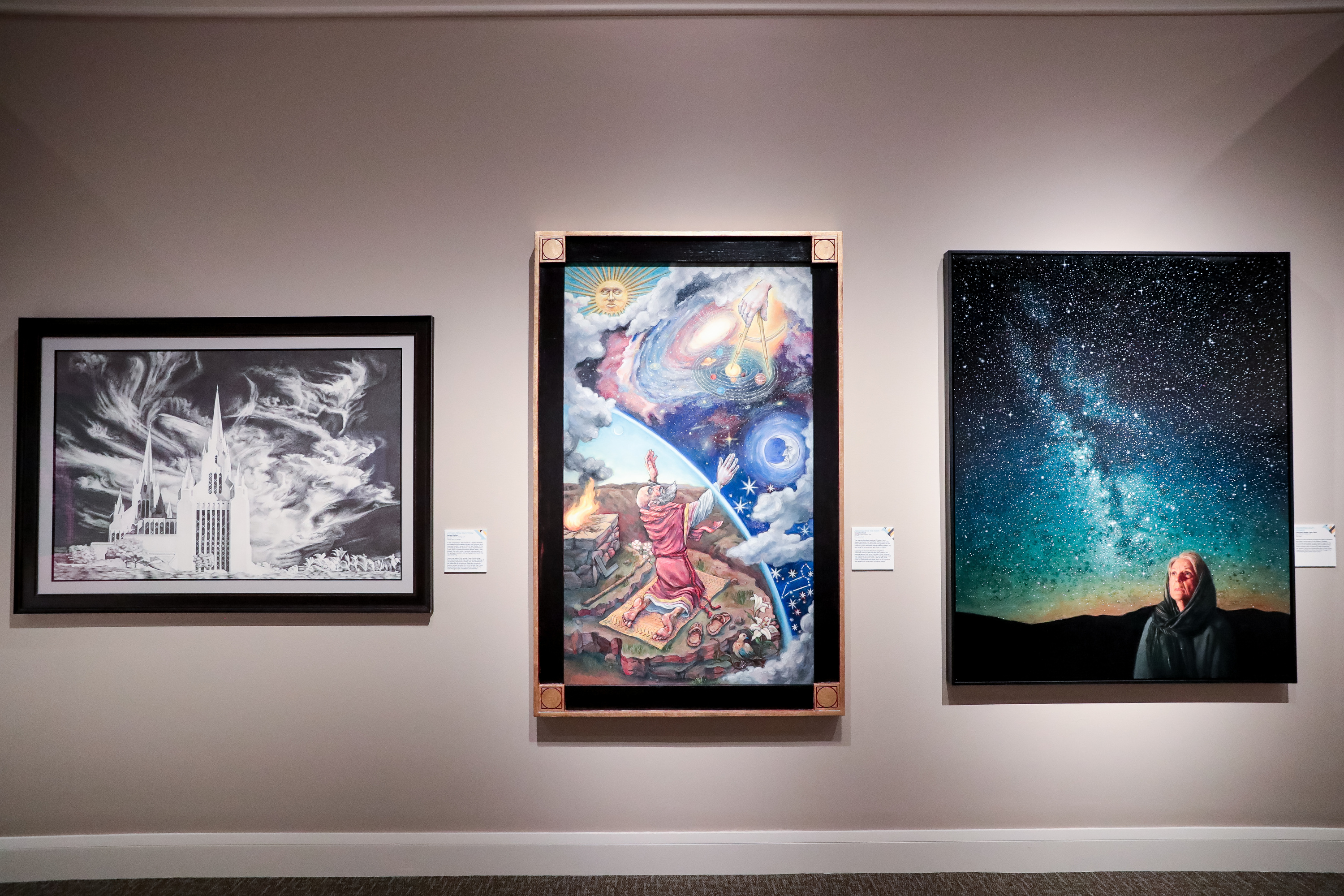 """""""Refuge from the Storm,"""" by Hames Shelley, """"Abraham and the Stars,"""" by Benjamin Pack, and """"Pondering God's Promise,"""" bu Courtney Vander Veur Matz, left to right, are pictured during a media preview for the 11th International Art Exhibition at the Church History Museum in Salt Lake City on Tuesday, March 12, 2019."""