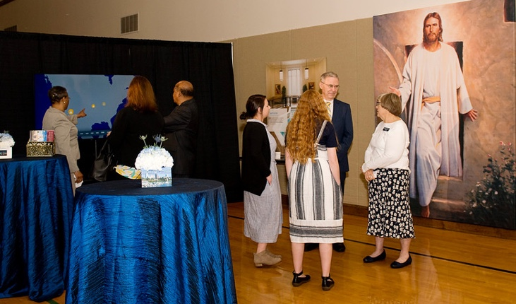 Visitors tour through the Memphis Tennessee Temple open house information hall in the stake center on the adjoining property of the temple in April 2019.