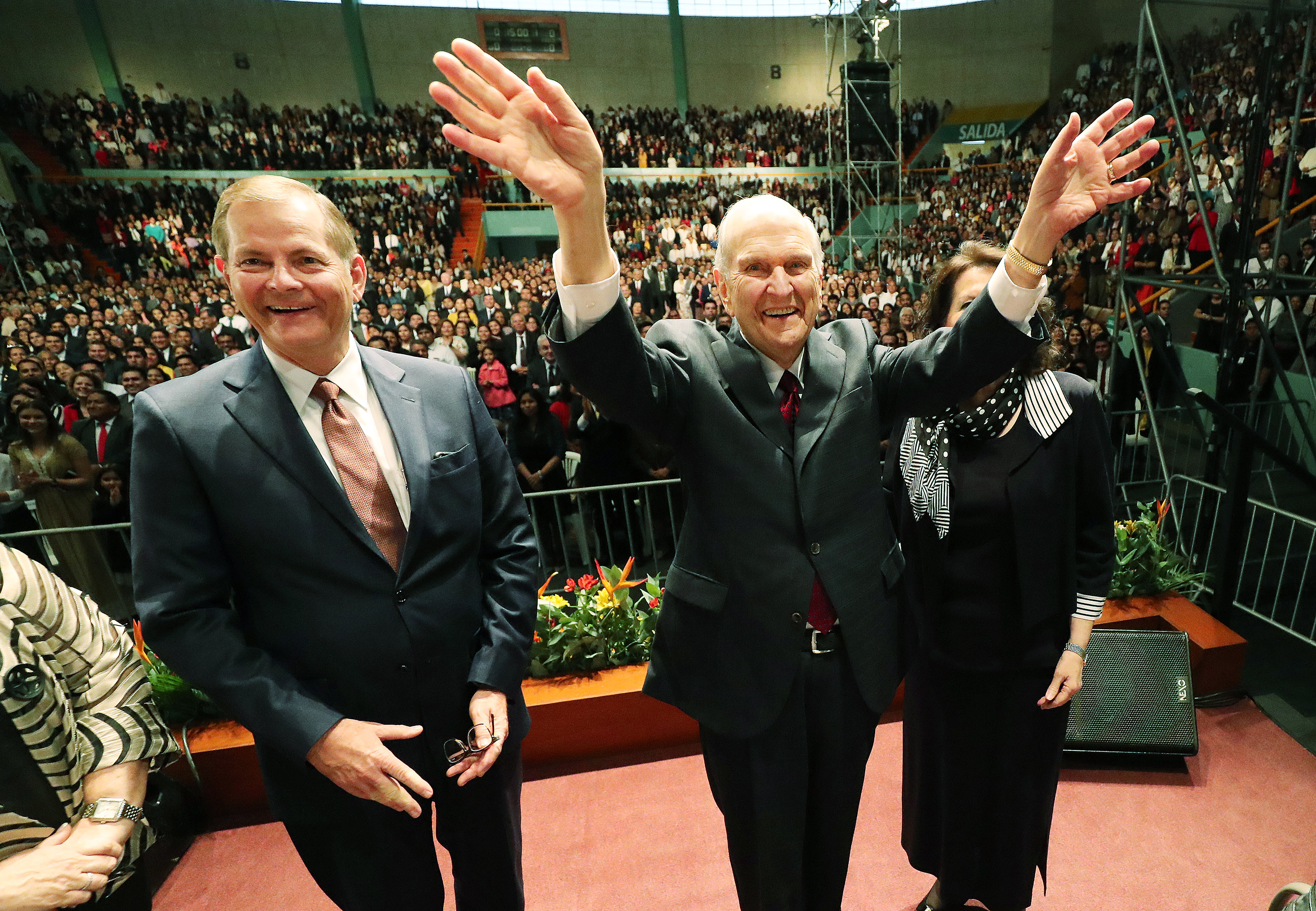 President Russell M. Nelson of The Church of Jesus Christ of Latter-day Saints and Elder Gary E. Stevenson, of the Quorum of the Twelve Apostles, wave to attendees at a devotional in Lima, Peru, on Oct. 20, 2018.