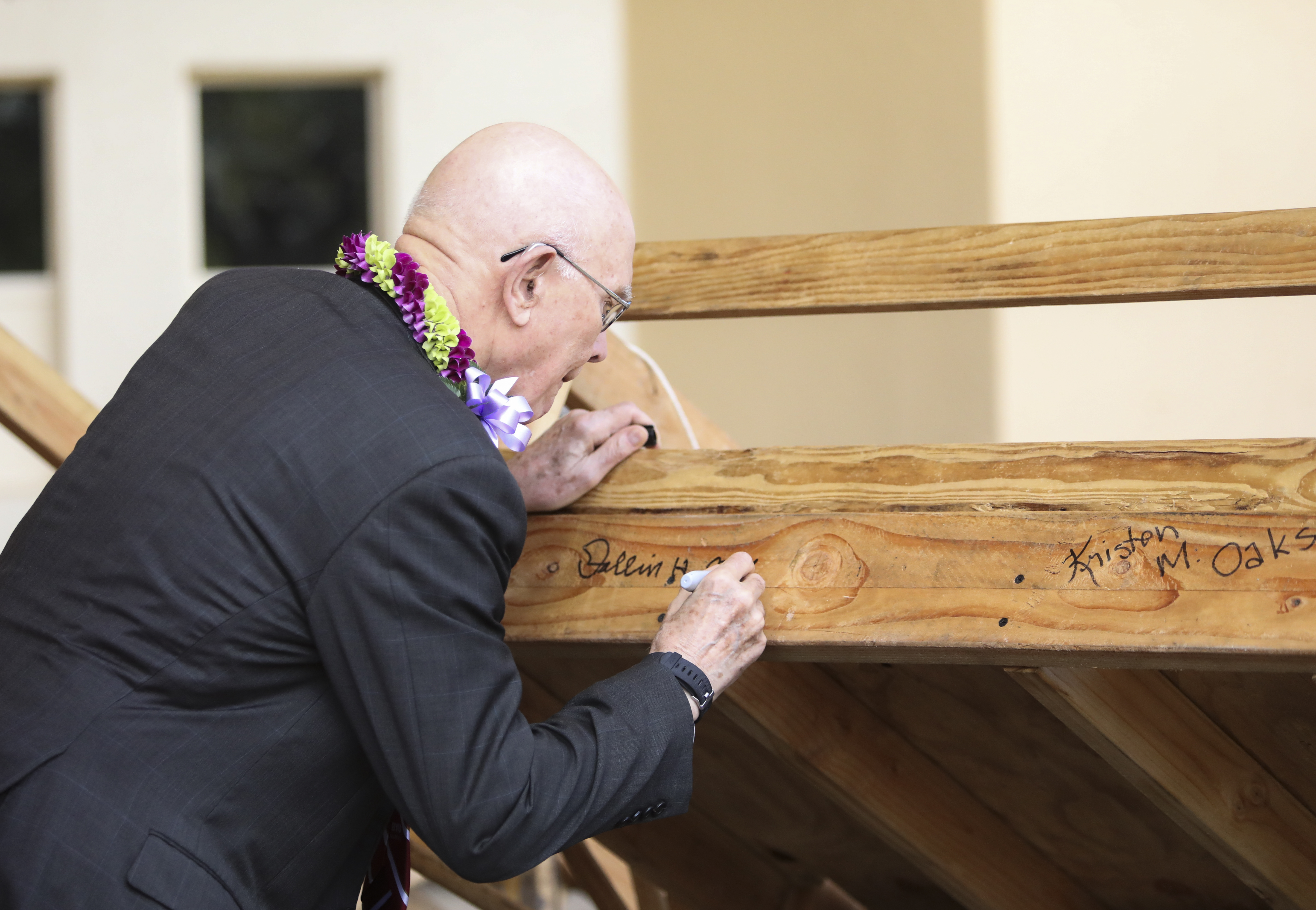 President Dallin H. Oaks, first counselor in the First Presidency, signs a handcart before a BYU-Hawaii devotional on June 11, 2019.
