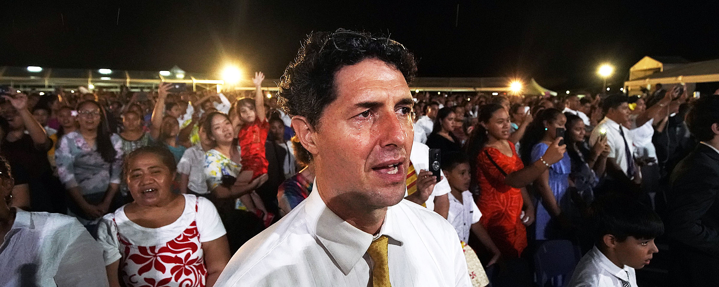 Jason Corry has tears in his eyes as President Russell M. Nelson of The Church of Jesus Christ of Latter-day Saints leaves following a devotional in Apia, Samoa, on Saturday, May 18, 2019. Many in attendance sang and returned waves from President Nelson and his wife, Sister Wendy Nelson.