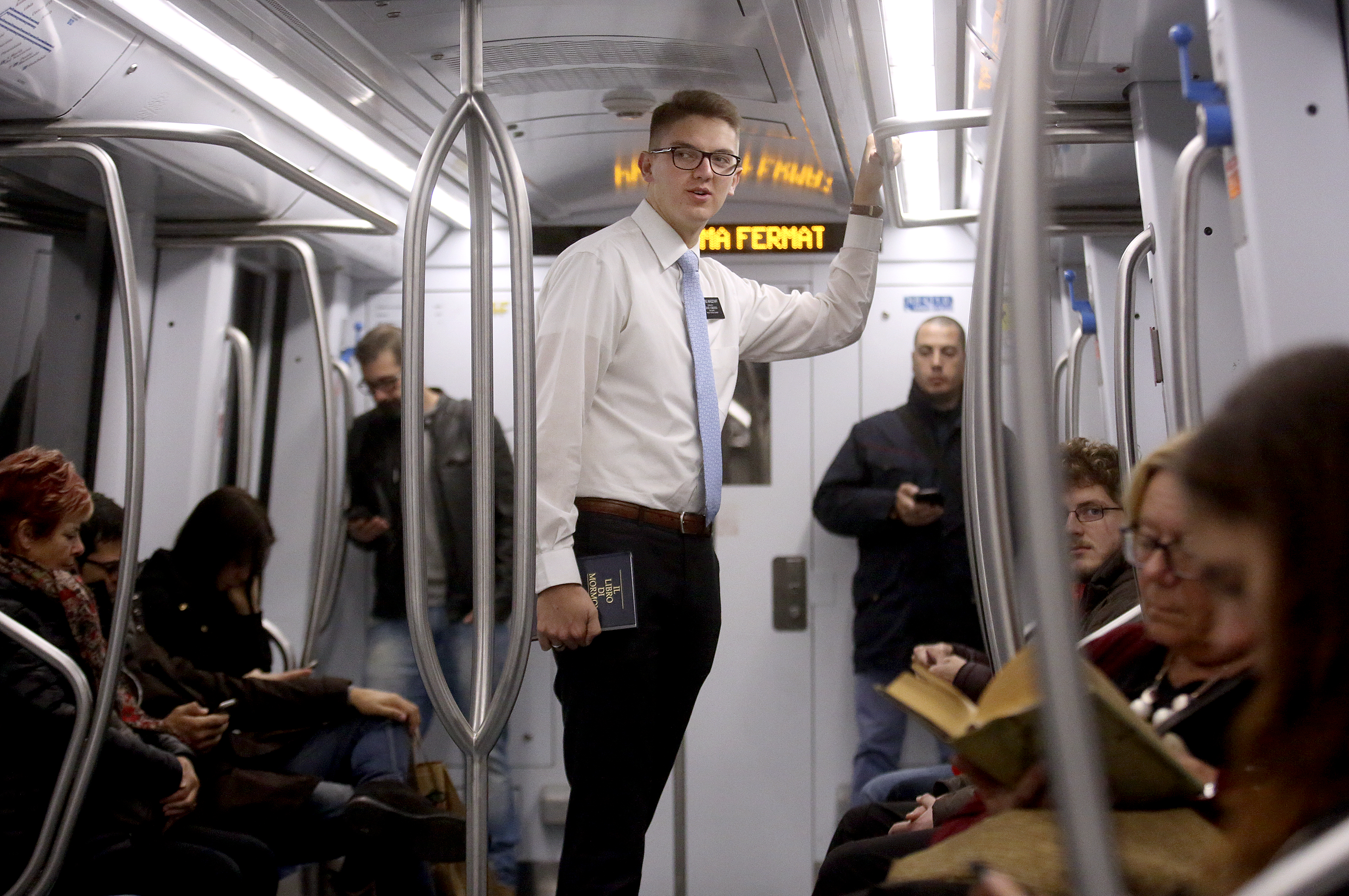 Elder Travis Wagstaff looks around a Metro car as part of his finding efforts in Rome, Italy, on Saturday, Nov. 17, 2018.