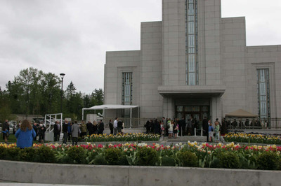 Crowds gather in front of the Vancouver British Columbia Temple on a cold, wet morning for dedication services.