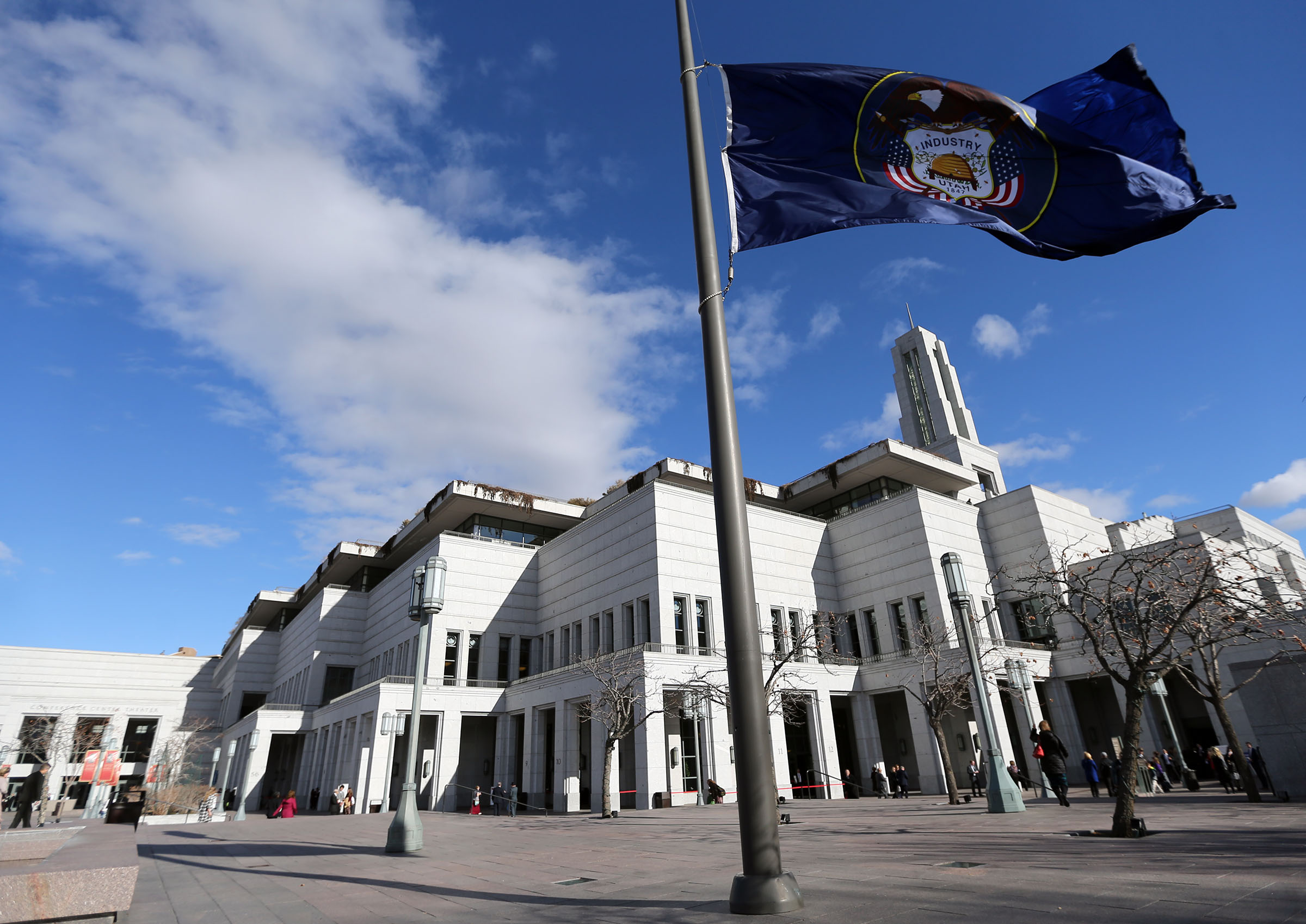 The Utah flag flies at half-staff as people arrive for President Thomas S. Monson's funeral at the Conference Center in Salt Lake City on Friday, Jan. 12, 2018.