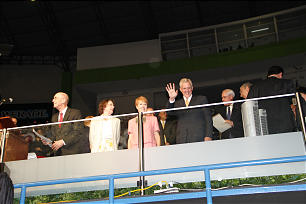 From left, President Henry B. Eyring, Sister Kathleen Eyring, Sister Katherine Christofferson and Elder D. Todd Christofferson acknowledge young performers from their seats at San Salvador's National Gymnasium.