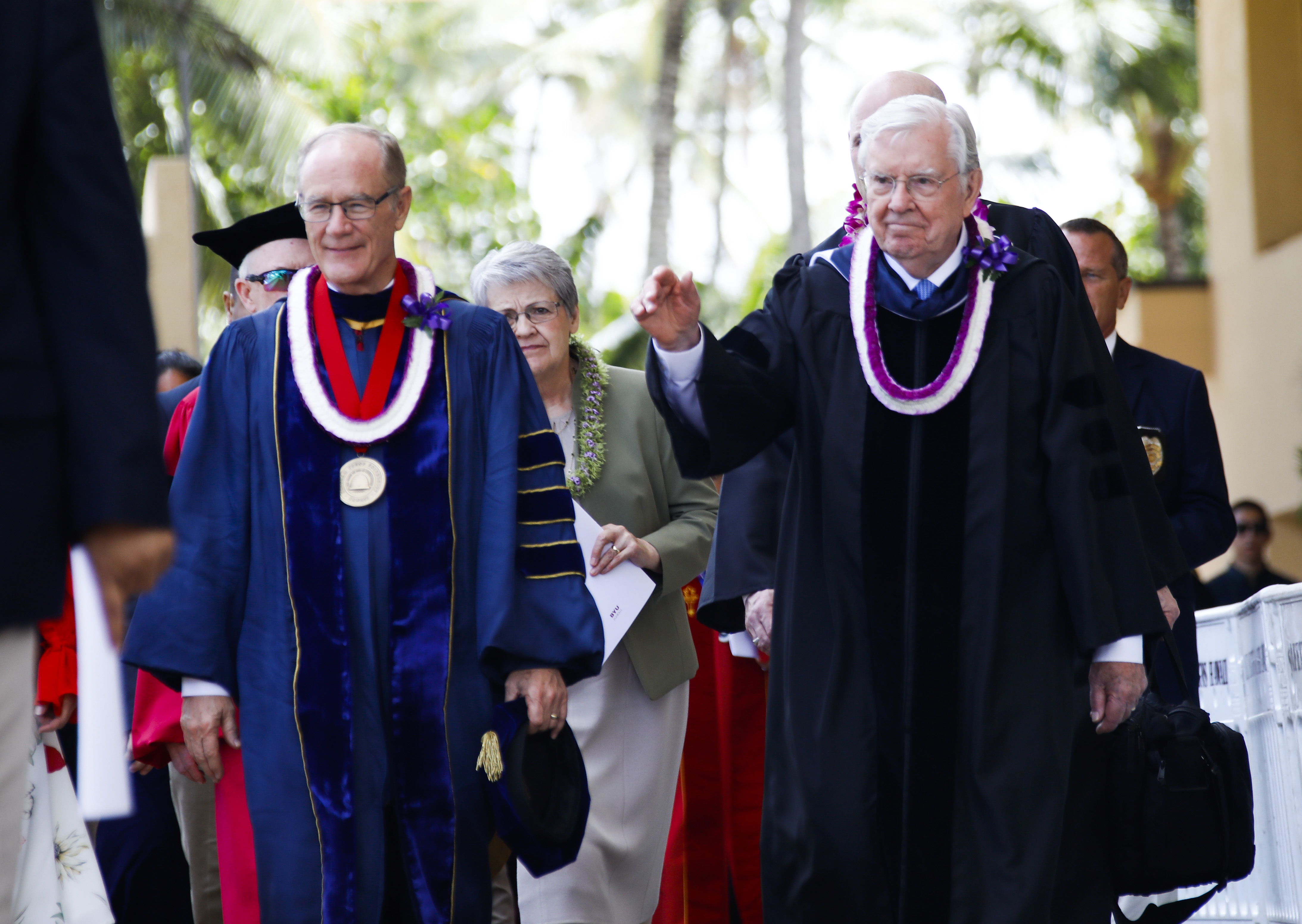 President M. Russell Ballard, right, walks with President John S. Tanner prior to the BYU-Hawaii Winter Semester Commencement ceremony on April 20, 2019.