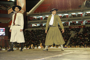 Young men assume a dramatic pose during traditional vacquero dance during the Sept. 8, 2012, LDS Argentina cultural celebration.