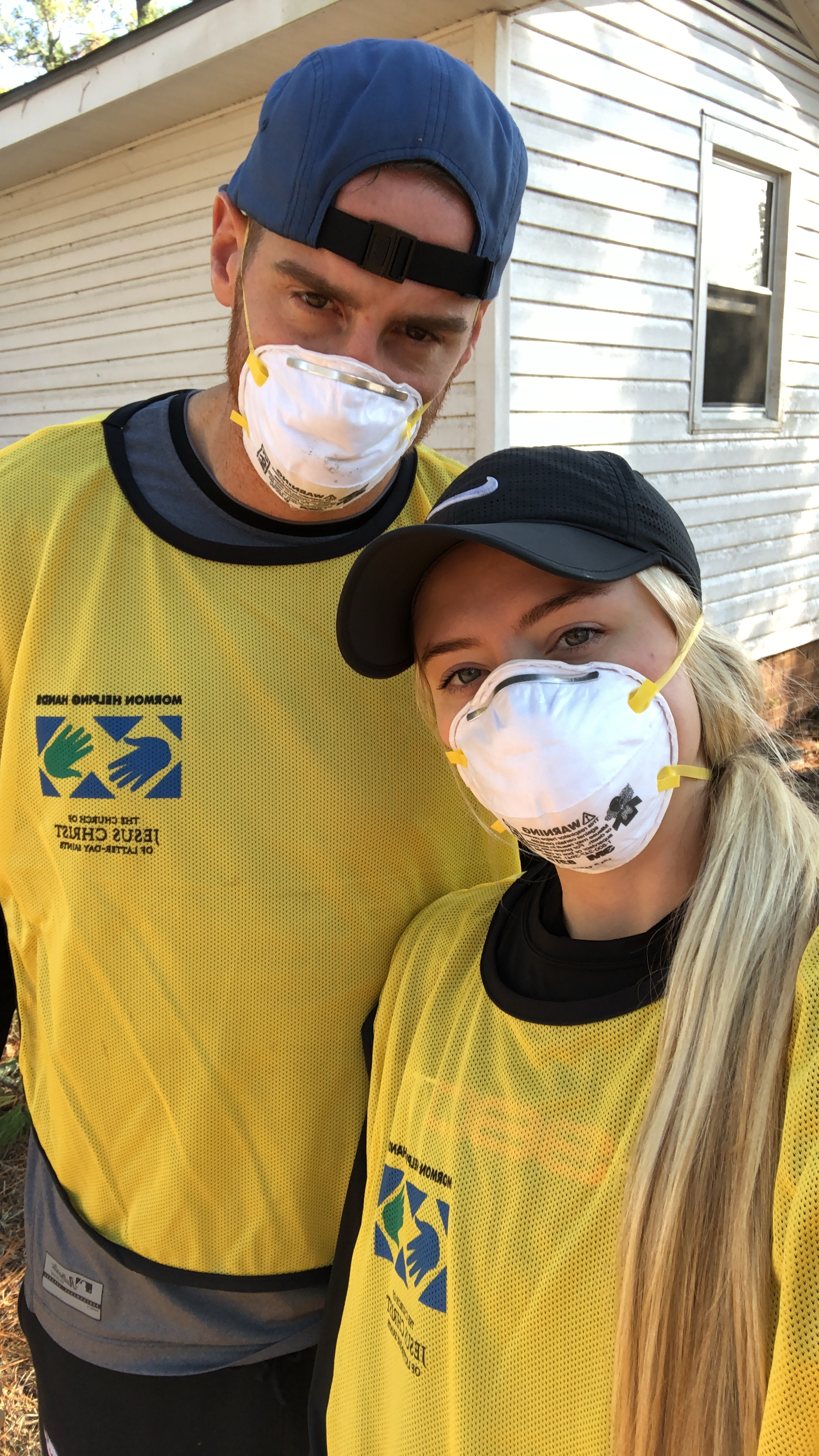 Former BYU athletes Mitch and Madie Mathews donned masks and yellow Helping Hands vests during a recent cleanup project in Wilmington, North Carolina.