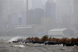Wind-blown mist from the Hudson River along with driving rain in West New York, N.J. fills the air Monday, Oct. 29, 2012 as Hurricane Sandy lashed the East Coast. The Manhattan borough of New York is in the background.