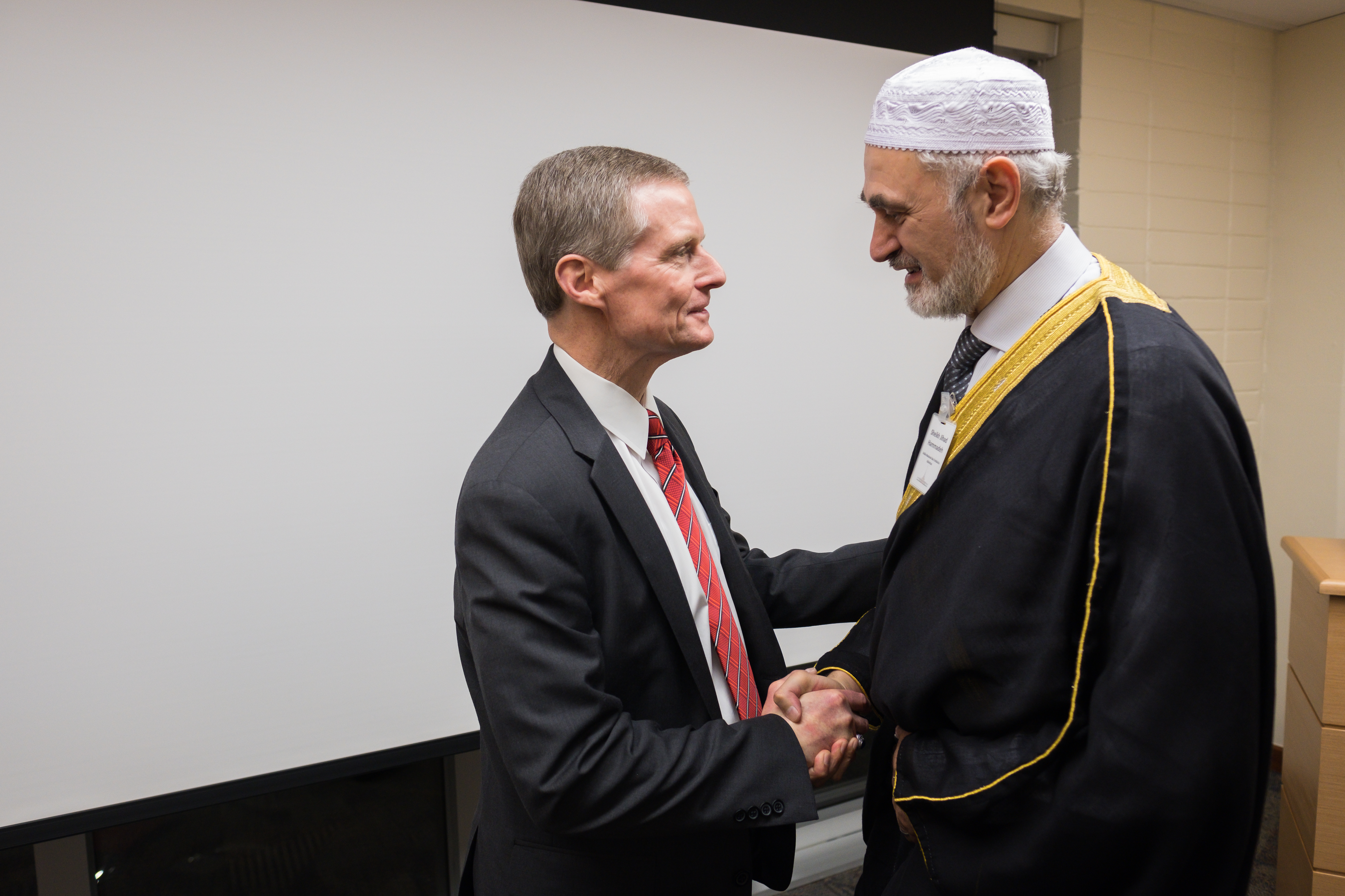 Elder David A. Bednar of the Quorum of the Twelve Apostles greets member of another faith during a LDS Church-sponsored event in Sao Paulo promoting religious freedom.
