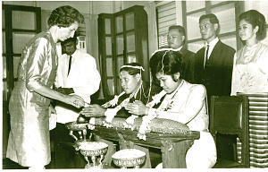 Virginia Lewis presents a gift during a traditional Thai wedding in the mid-1960s while serving as Relief Society president. She is the oldest descendant of two pioneer families who helped establish the city of Draper, where a new temple will soon be dedicated.