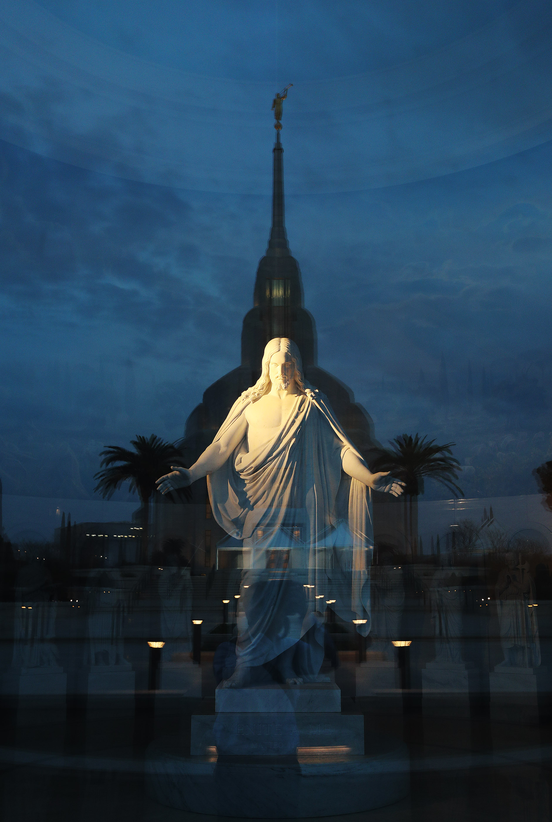 The Christus statue is illuminated in the Rome Italy Temple Visitors' Center with a reflection of the temple in Rome, Italy, on Friday, March 8, 2019.
