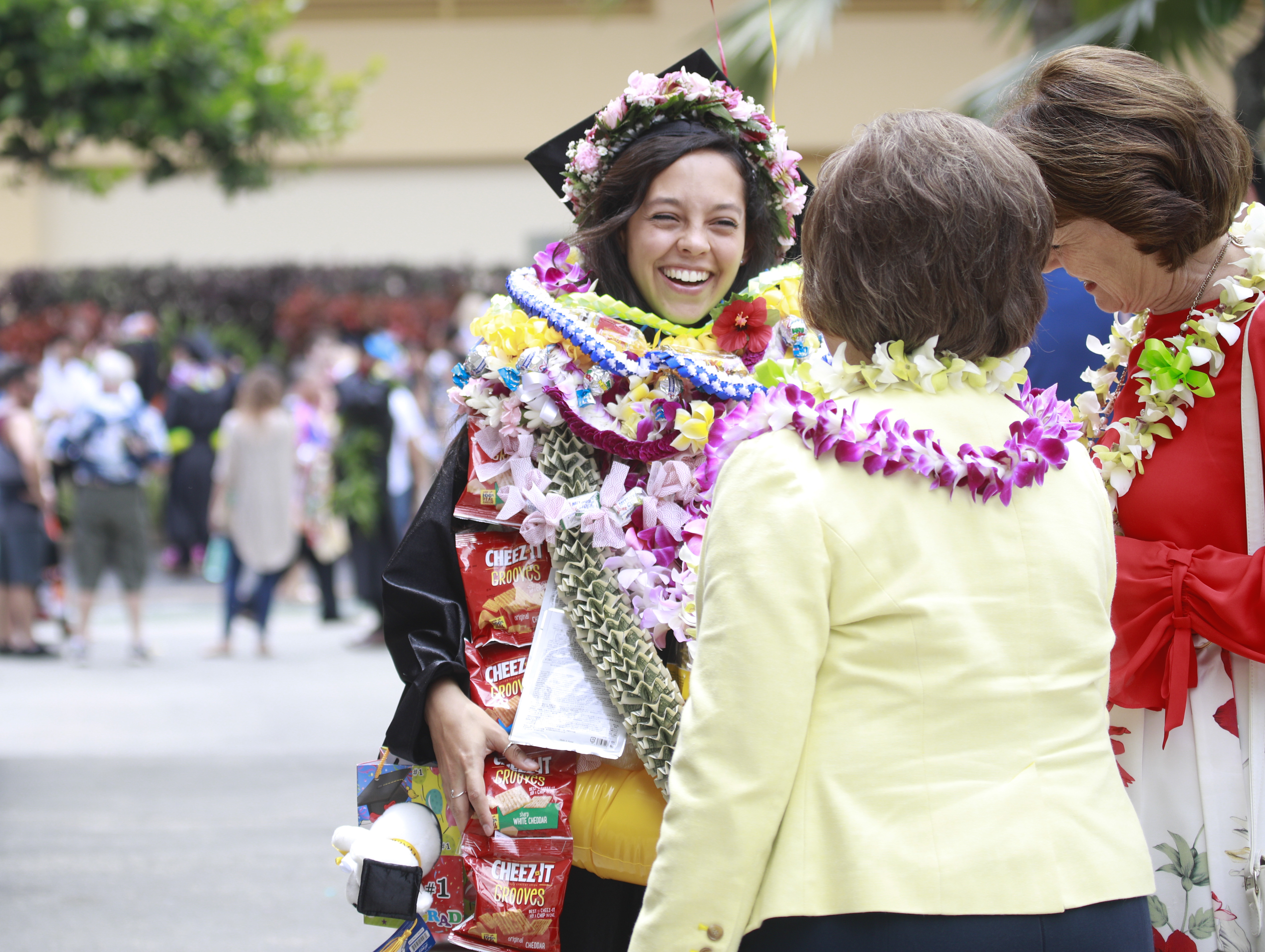 Graduates of BYU-Hawaii celebrate with supporters after commencement exercises on June 30.