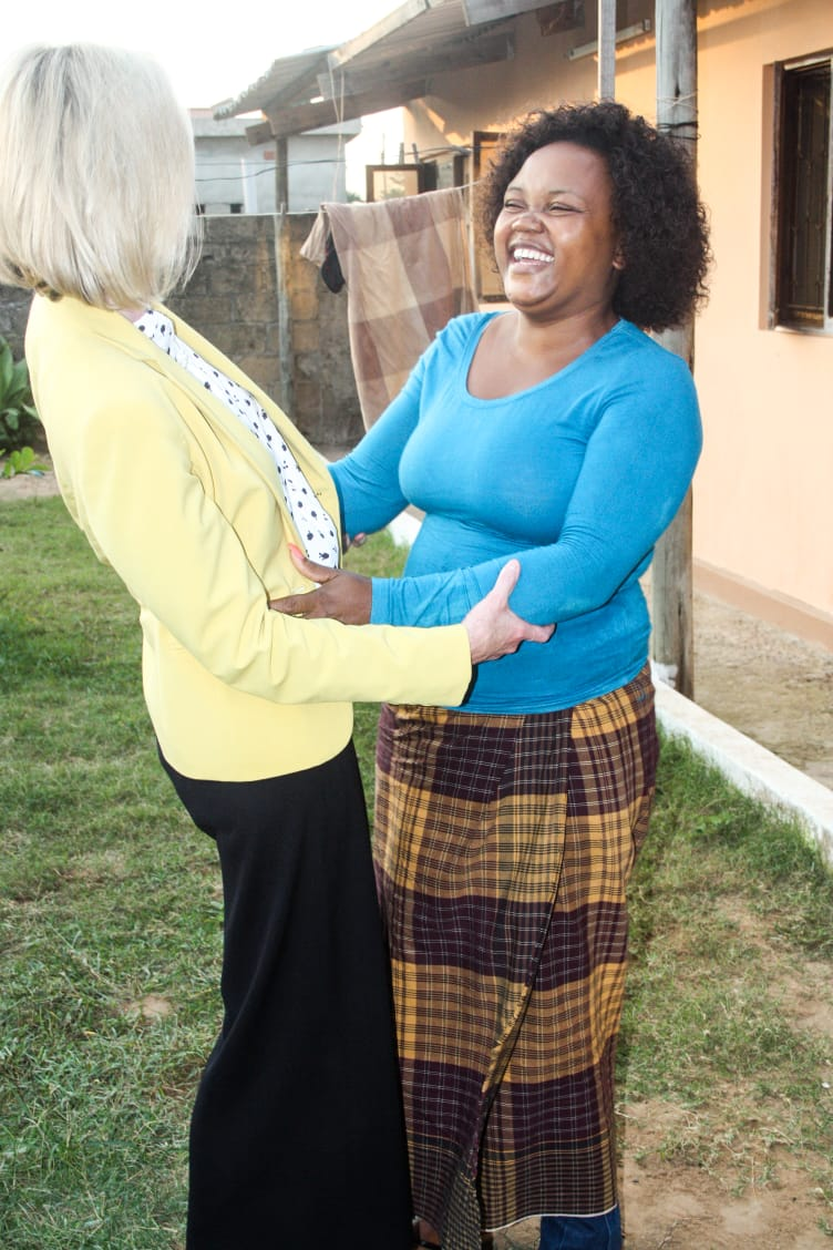 Sister Bonnie H. Cordon laughs with a member in Maputo, Mozambique, during a ministering home visit in May 2019.