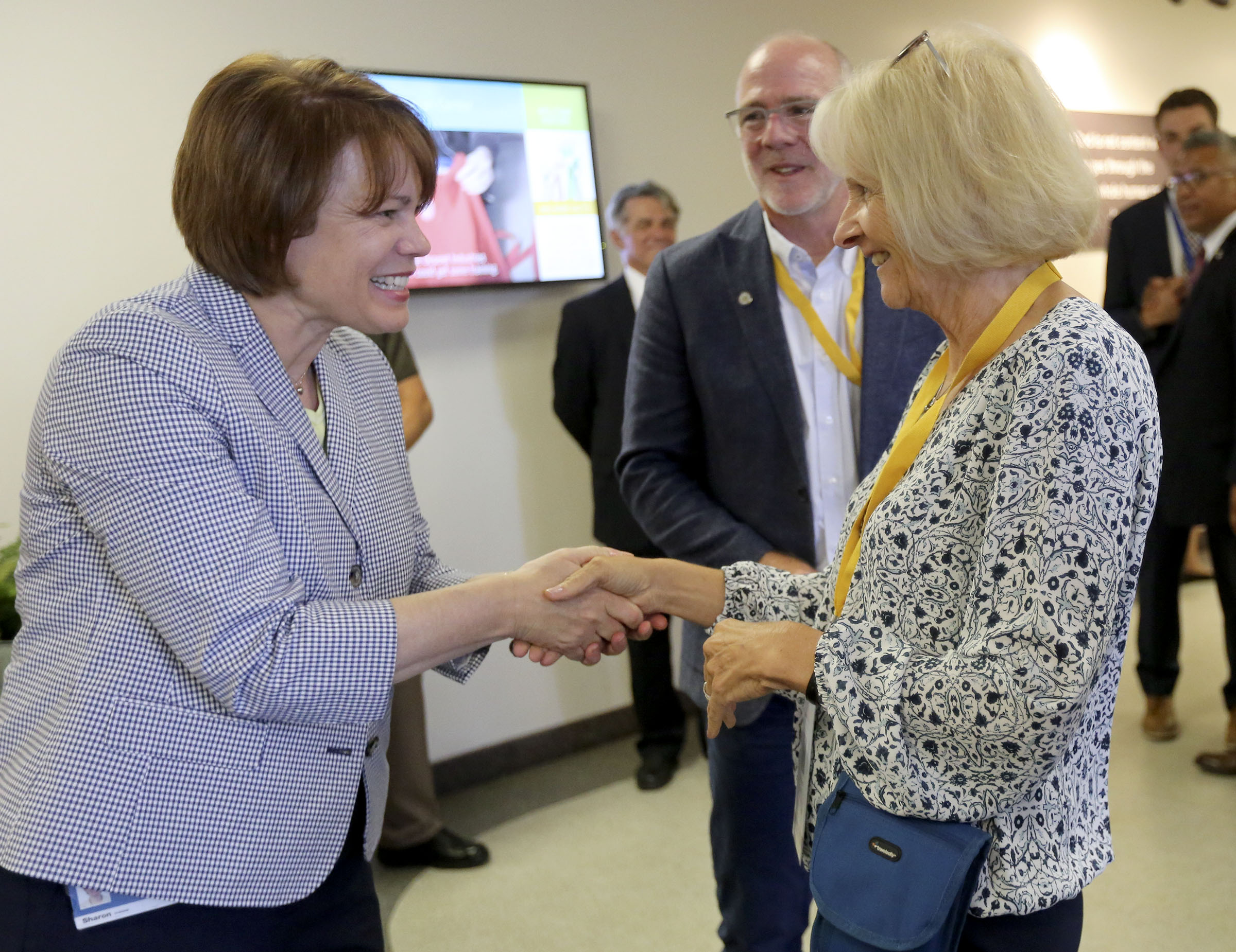 Sister Sharon Eubank, first counselor in the Relief Society general presidency, shakes hands with Wisconsin First Lady Kathleen Evers before giving a tour to spouses of U.S. governors at the Latter-day Saint Humanitarian Center in Salt Lake City on Thursday, July 25, 2019.