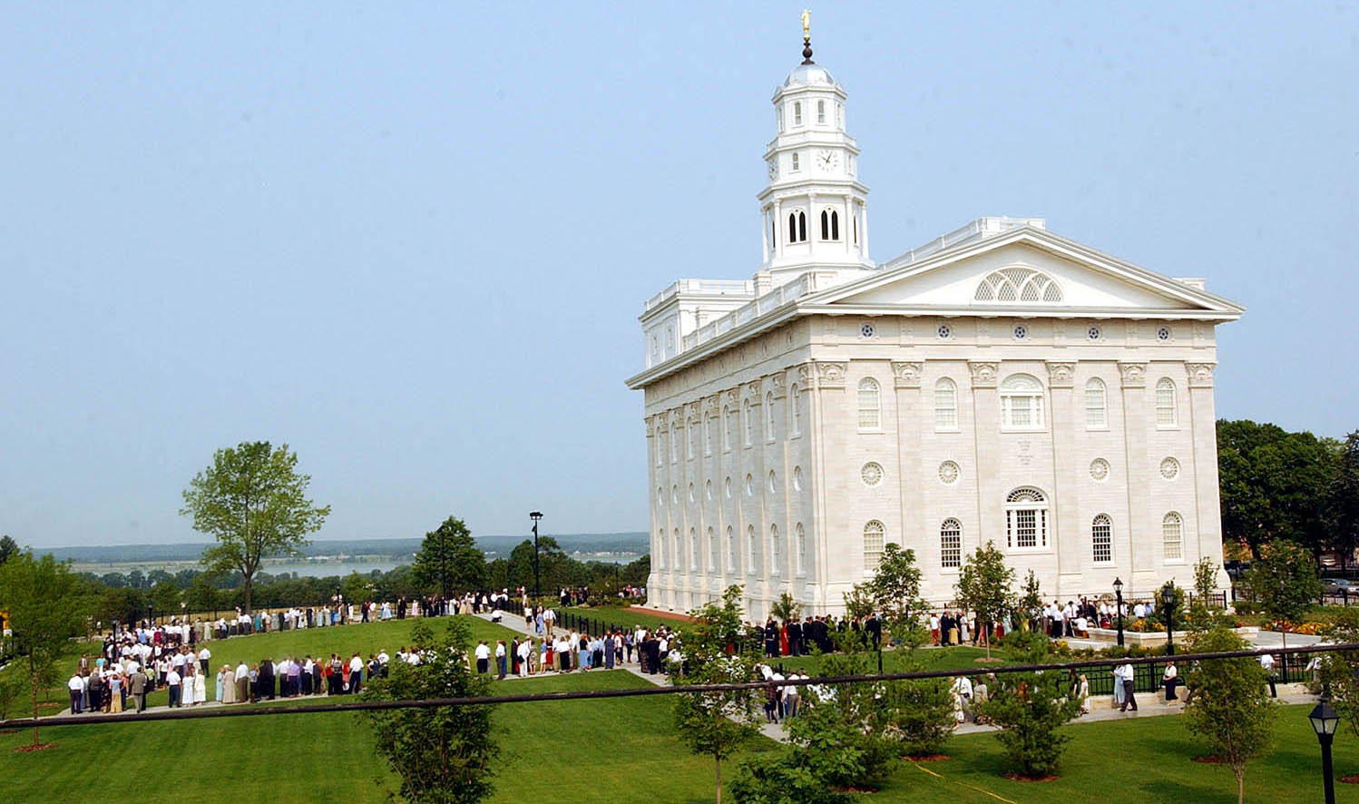 Latter-day Saints wait in line to attend a dedication session of the Nauvoo Illinois Temple June 28, 2002.