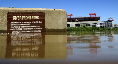 A sign for Riverfront Park is visible as floodwaters from the Cumberland River recede on Tuesday, May 4, 2010 in Nashville, Tenn. LP Field, home of the Tennessee Titans, is visible across the river. The Cumberland River that submerged parts of Music City's historic downtown began to recede Tuesday after being swollen by heavy rain and the flooding creeks that feed into it.