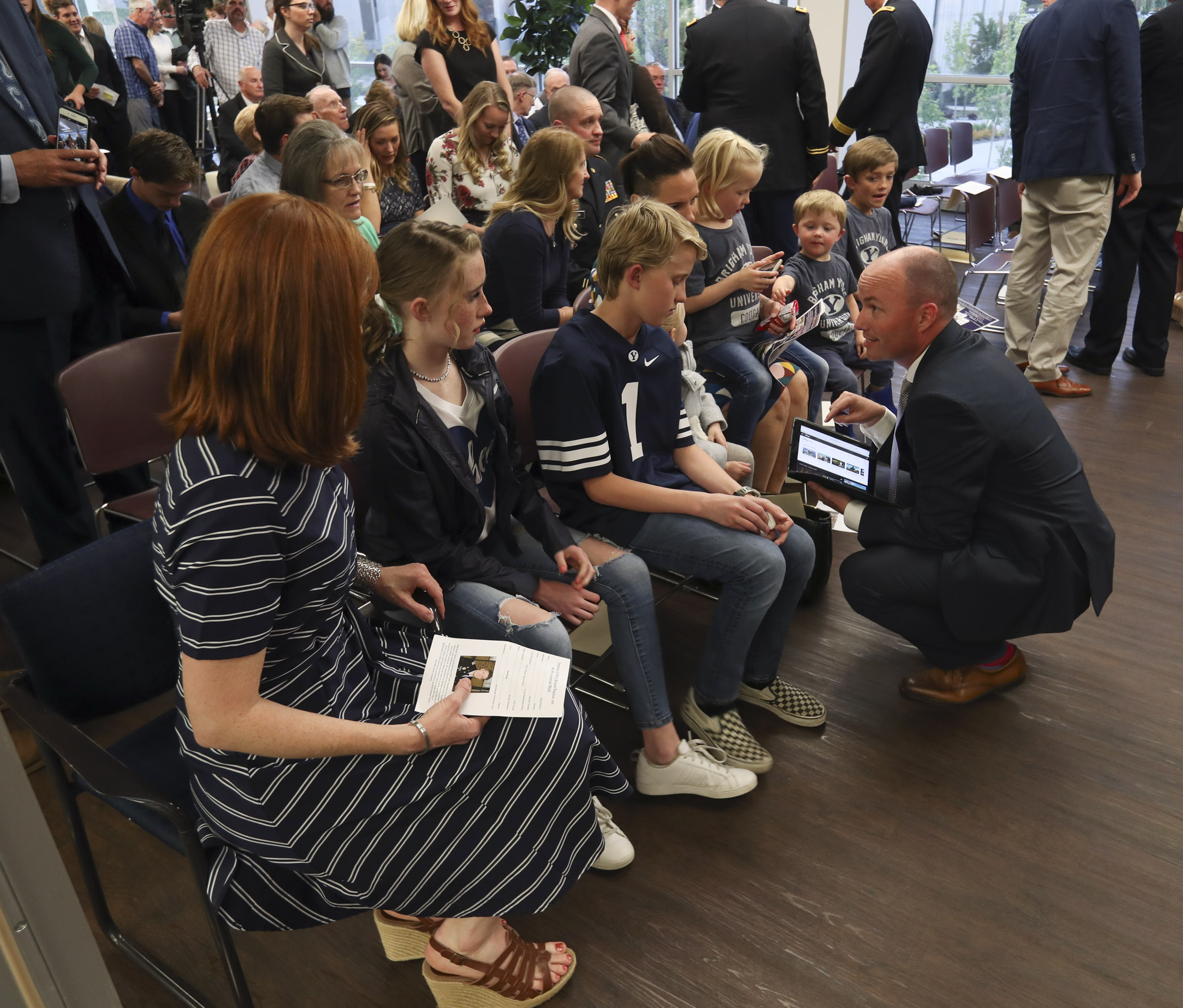 Lt. Gov. Spencer Cox talks with Jennie Taylor and her children during a ceremony where the name of her husband, Maj. Brent Taylor, was added to the Reflection Room Memorial Wall in the Wilkinson Center on the BYU campus in Provo on Thursday, May 23, 2019. Taylor was killed in Afghanistan in 2018.