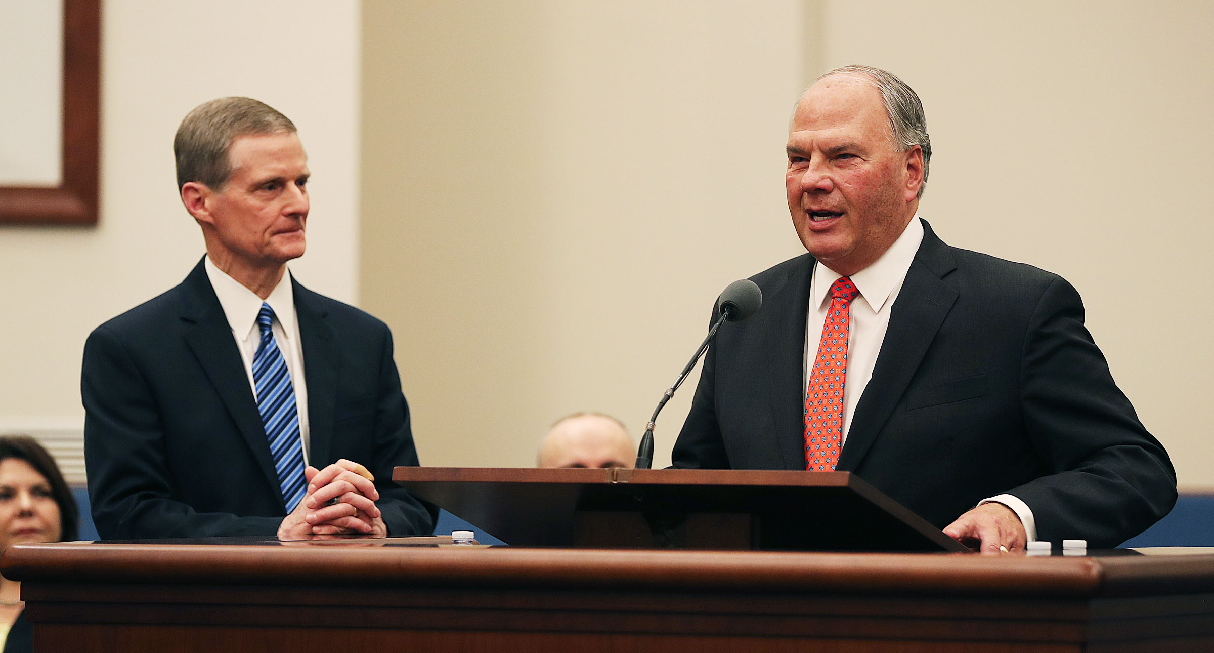 Elder Ronald A. Rasband, right, of the Quorum of the Twelve Apostles of The Church of Jesus Christ of Latter-day Saints speaks following an invitation by Elder David A. Bednar at a press briefing in a meetinghouse on the Rome Italy Temple grounds on Monday, Jan. 14, 2019.