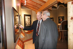 Ray Halls discusses elements of the exhibit with museum volunteer Donis Meiners.